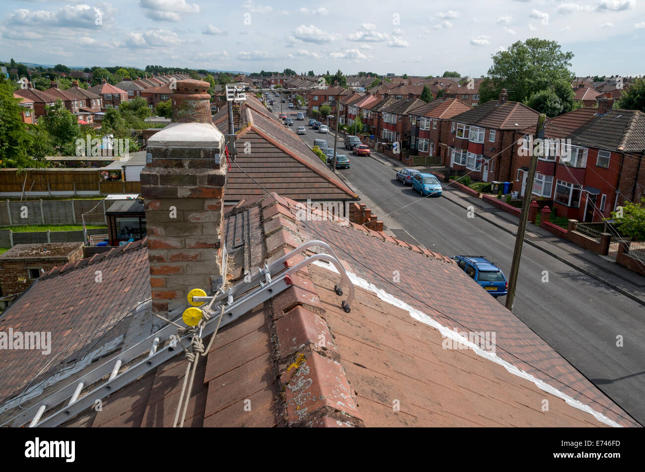 Roof Top View Of A Chimney Undergoing Repairs With A Roof