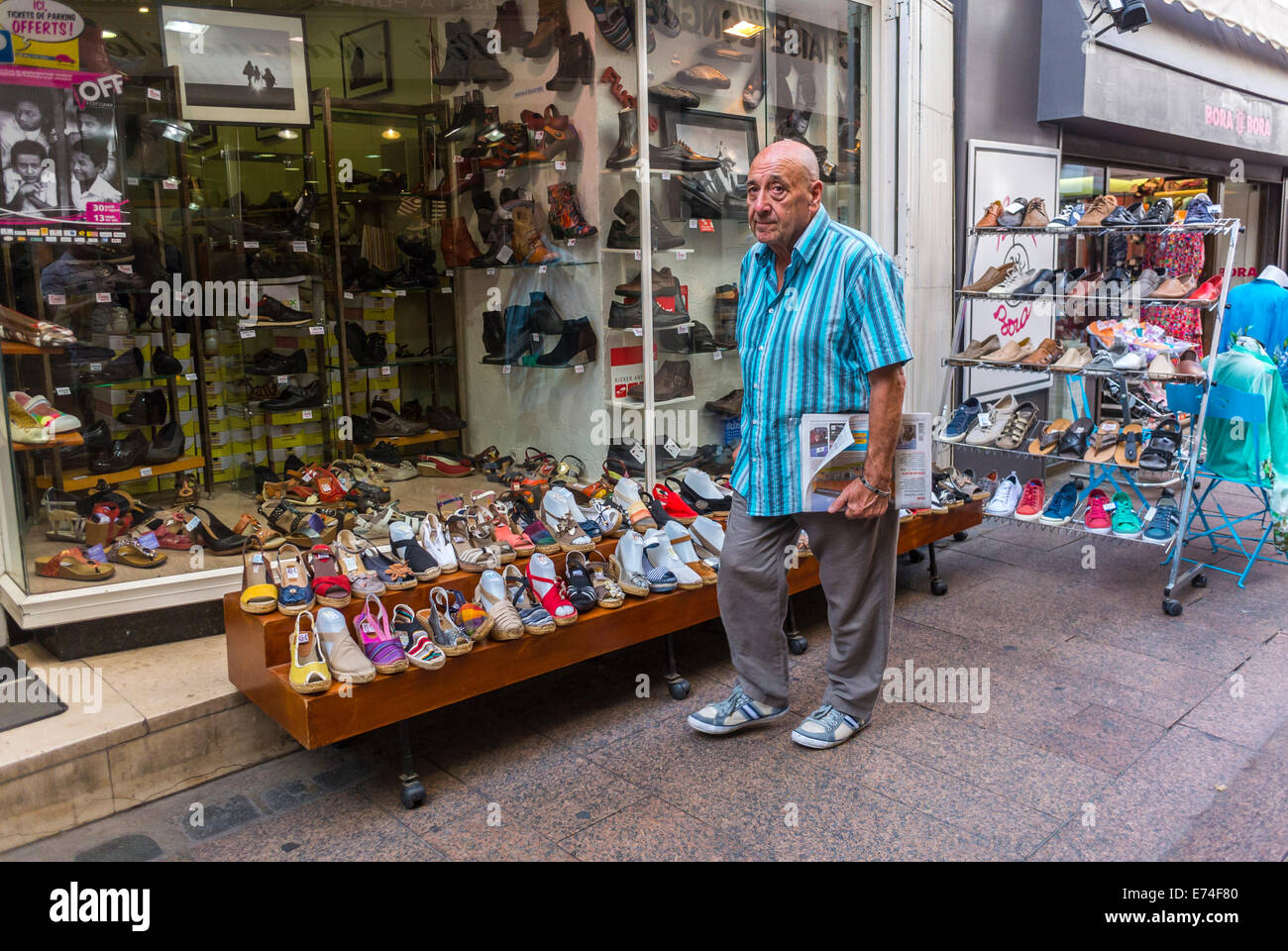 Perpignan france man walking by local shoe stores in old city stock photo royalty free image - Boutique free perpignan ...