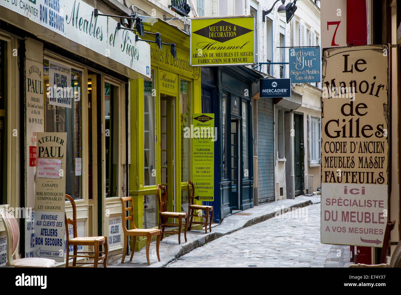 furniture company signs along passage du chantier near faubourg stock photo royalty free image. Black Bedroom Furniture Sets. Home Design Ideas