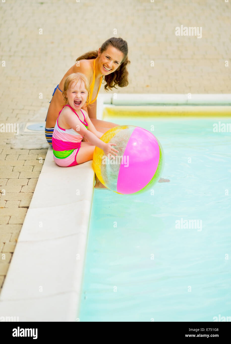 Happy Mother And Baby Girl With Ball Sitting Near Swimming Pool Stock Photo Royalty Free Image