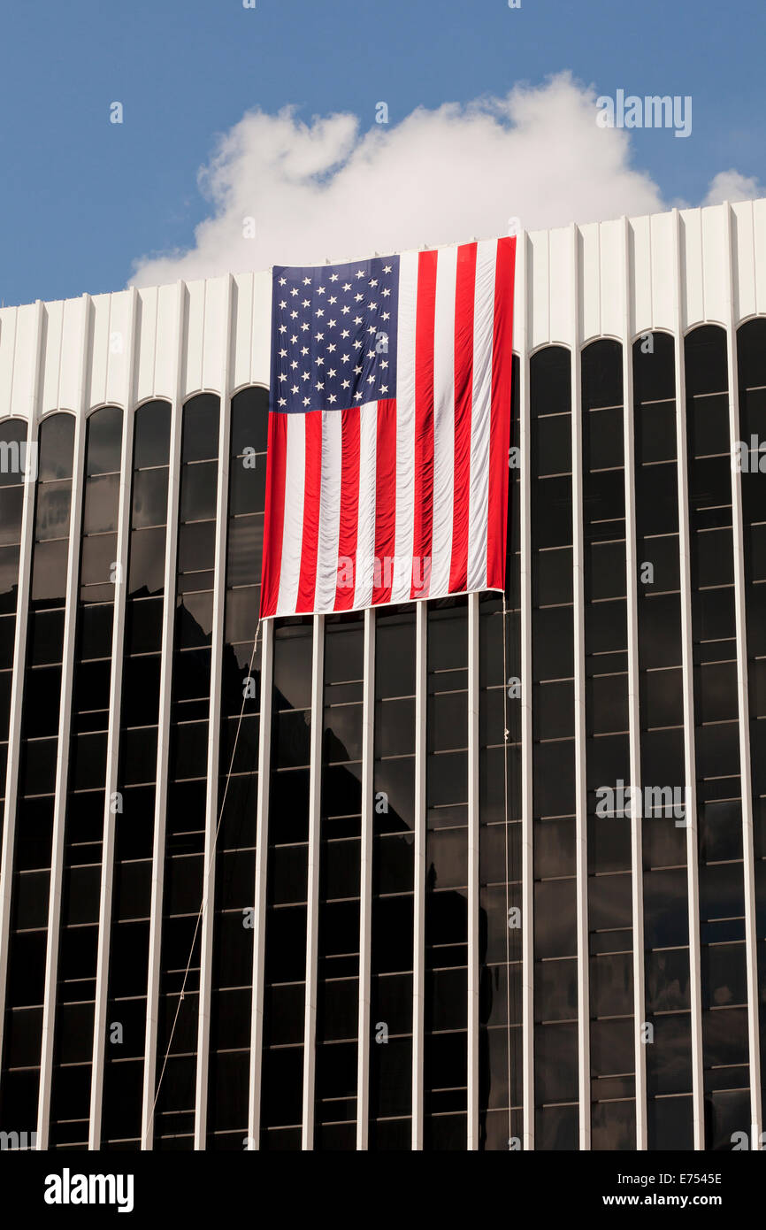 American Flag Hanging From High Rise Office Building