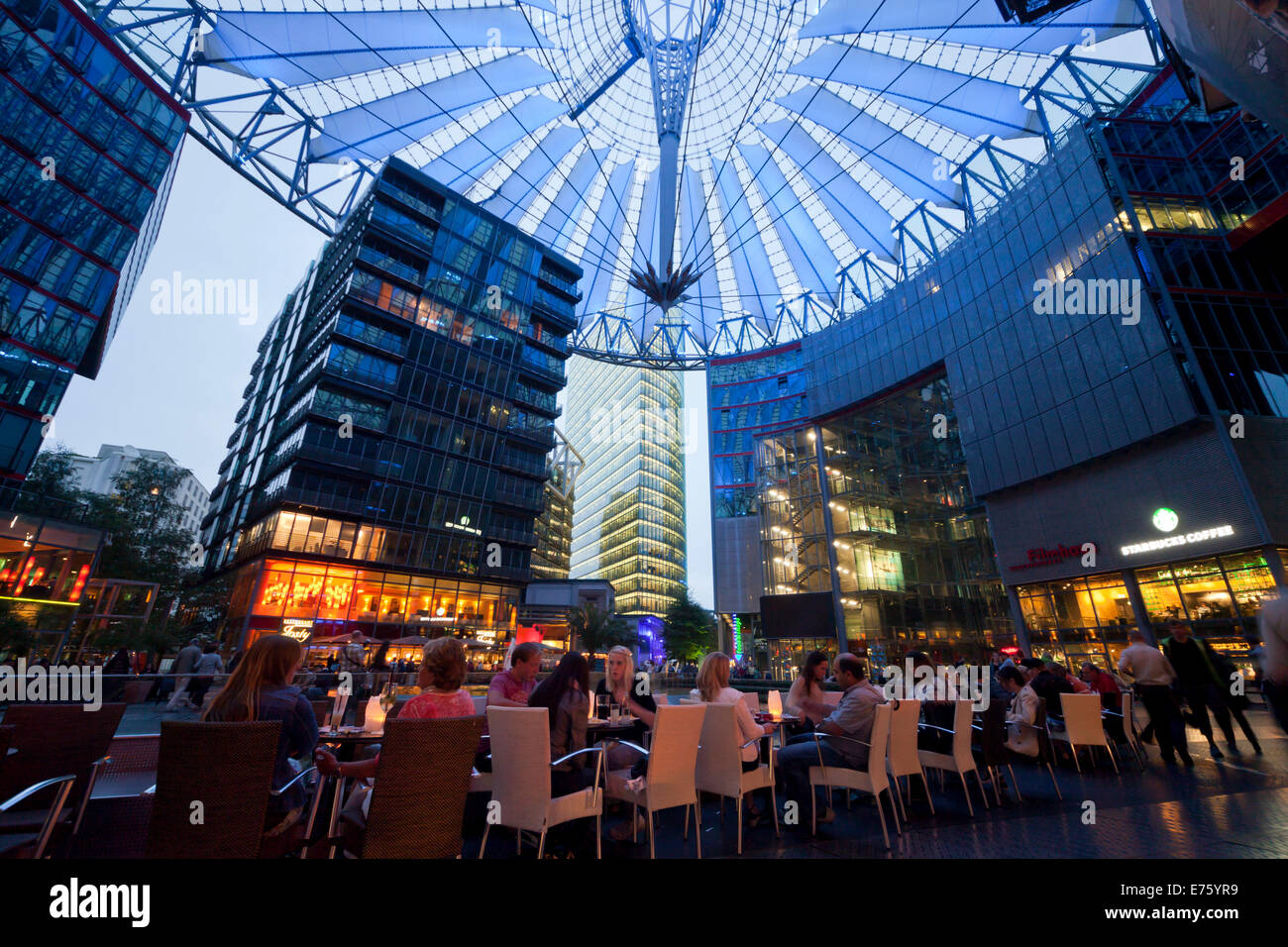 the illuminated dome and restaurants in the forum of the sony center stock photo royalty free. Black Bedroom Furniture Sets. Home Design Ideas