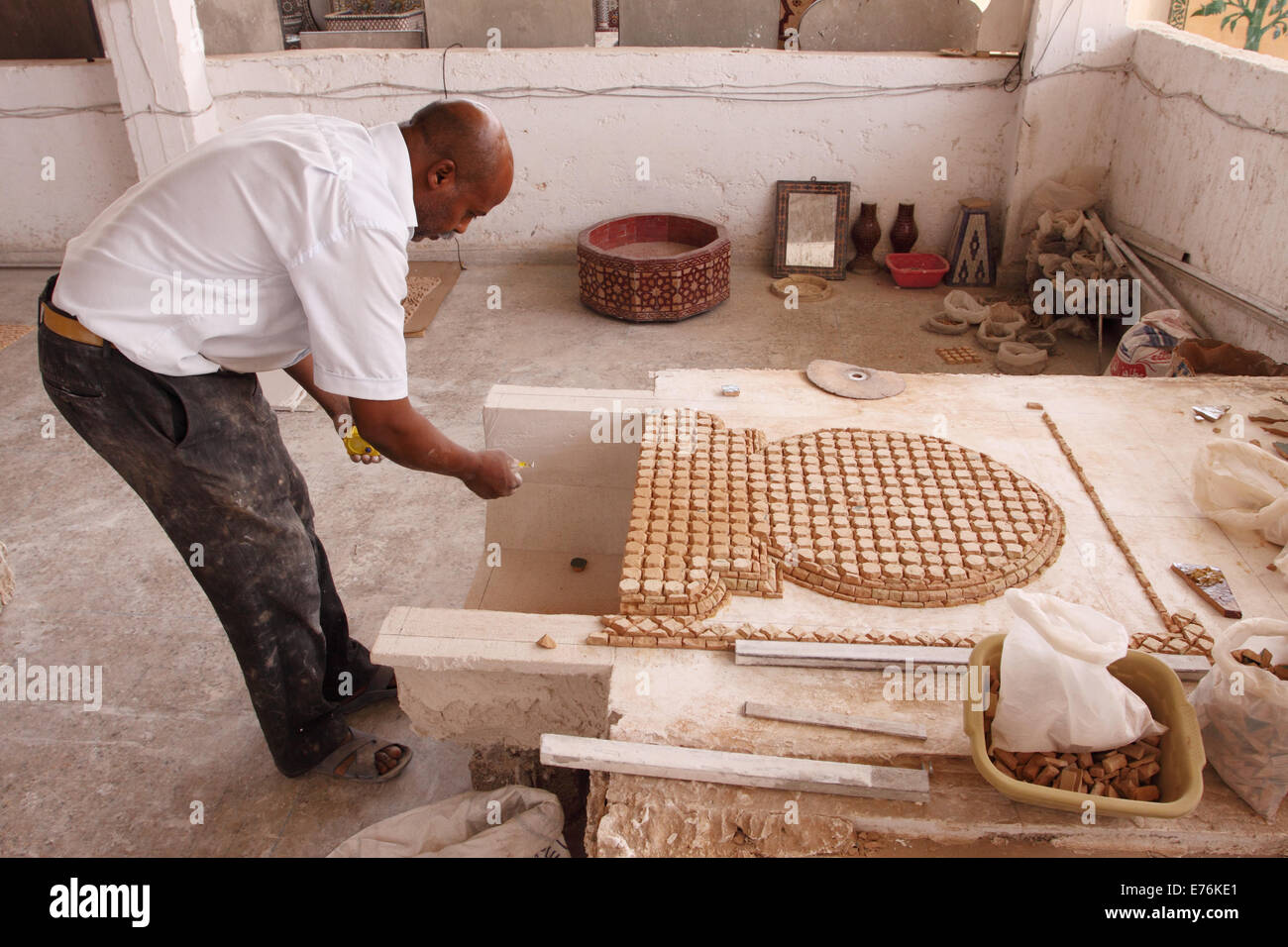 Fez fes morocco skilled worker making a ceramic tile mosaic the fez fes morocco skilled worker making a ceramic tile mosaic the mosaic is constructed inverted with the colour side face down dailygadgetfo Choice Image