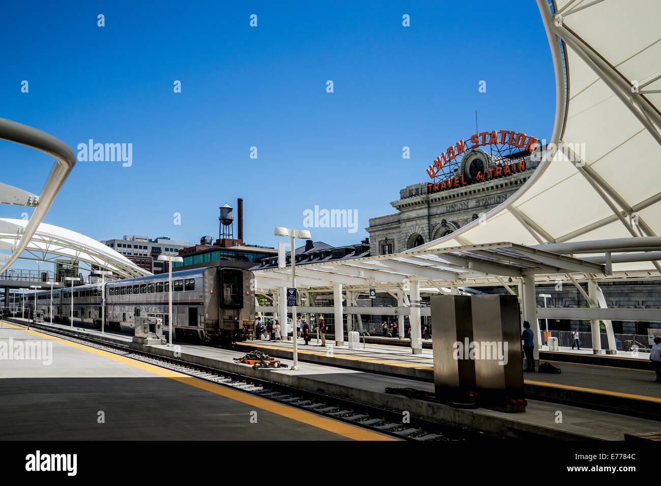 Denver Union Railroad Station white protective canopy and departing train passangers & Denver Union Railroad Station white protective canopy and ...