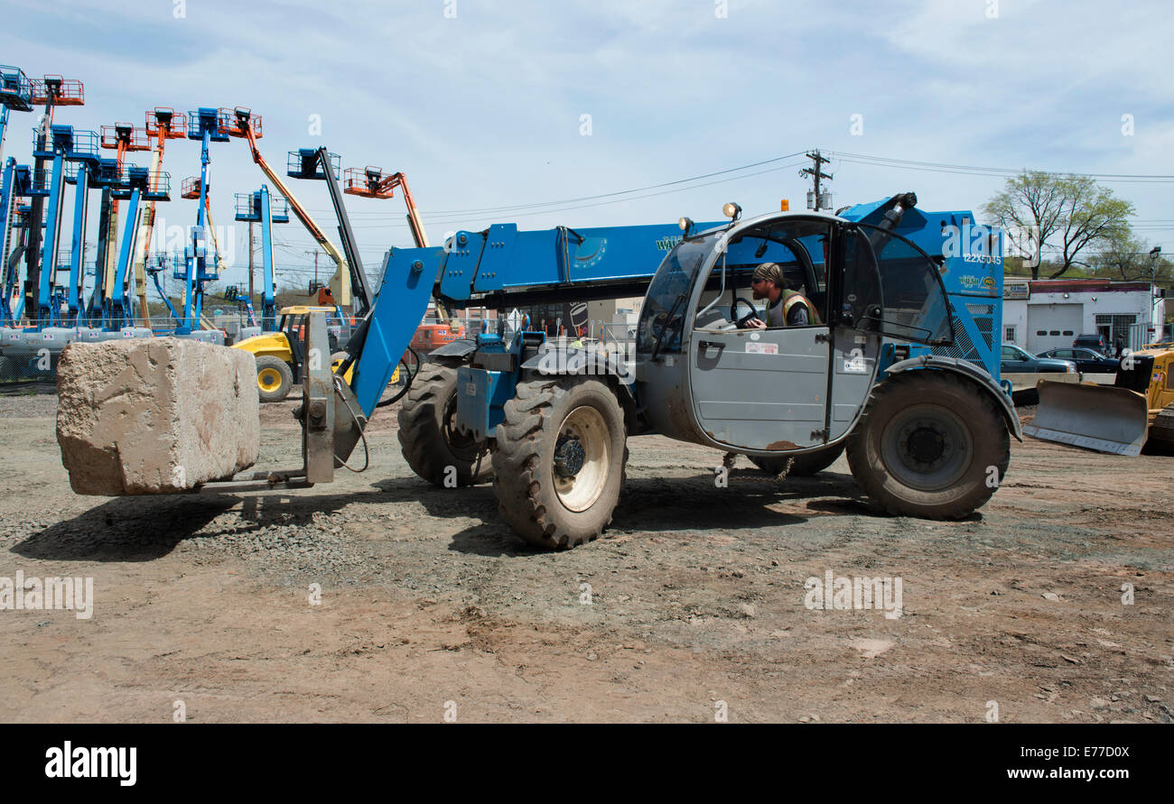 All terrain or rough terrain forklift at construction site at new stock photo royalty free for Terrain construction