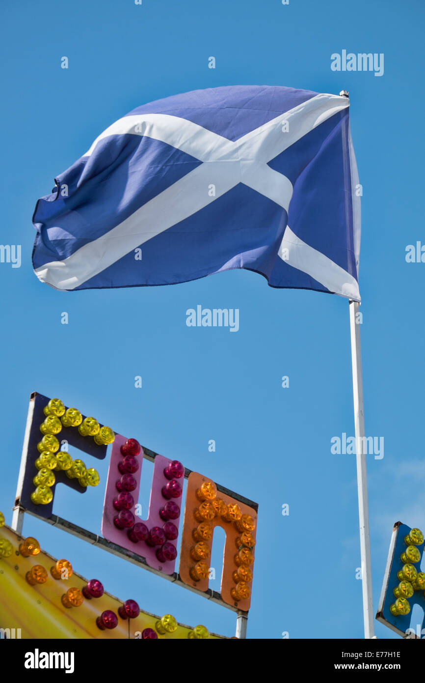 The saltire the scottish national flag flying atop a flagpole the saltire the scottish national flag flying atop a flagpole above the word fun written in multi coloured fairground lights sciox Image collections
