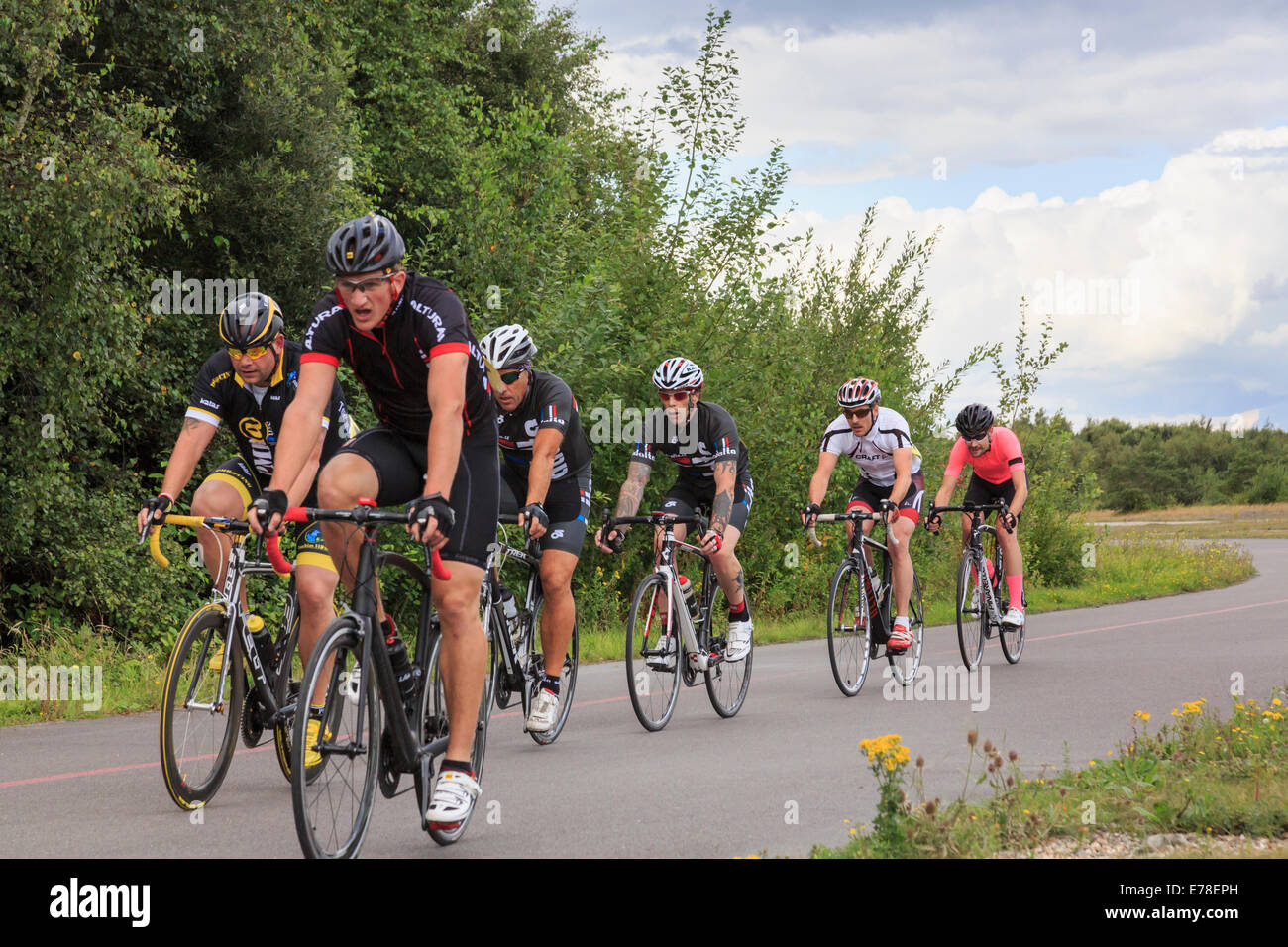 Men Cycle Racing In A Bike Race Organised By British Cycling For
