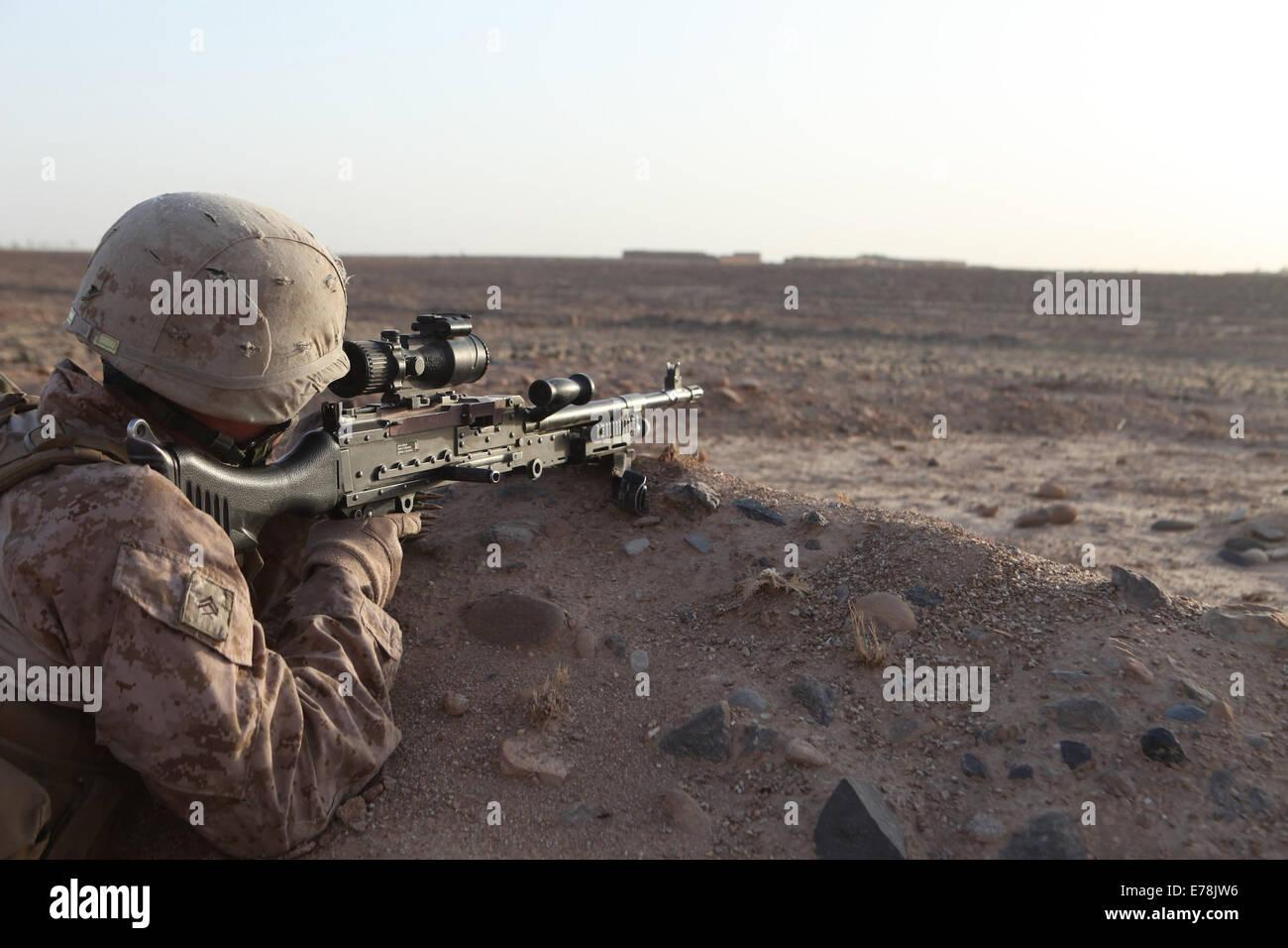 U.s. Marine Corps Cpl. Kevin Midgley, A Machine Gunner With Bravo ...