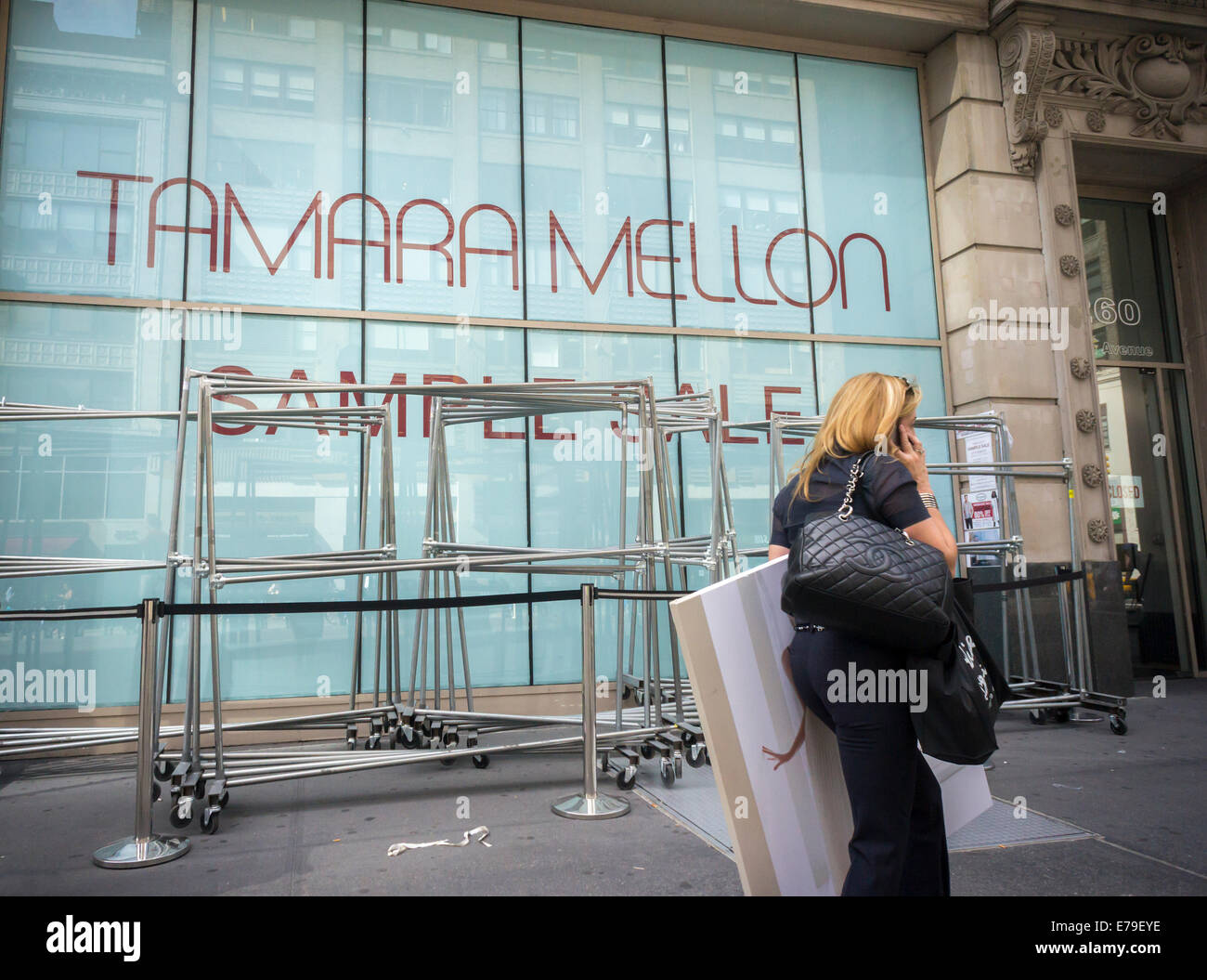 Unused clothing racks outside a Tamara Mellon sample sale in New ...
