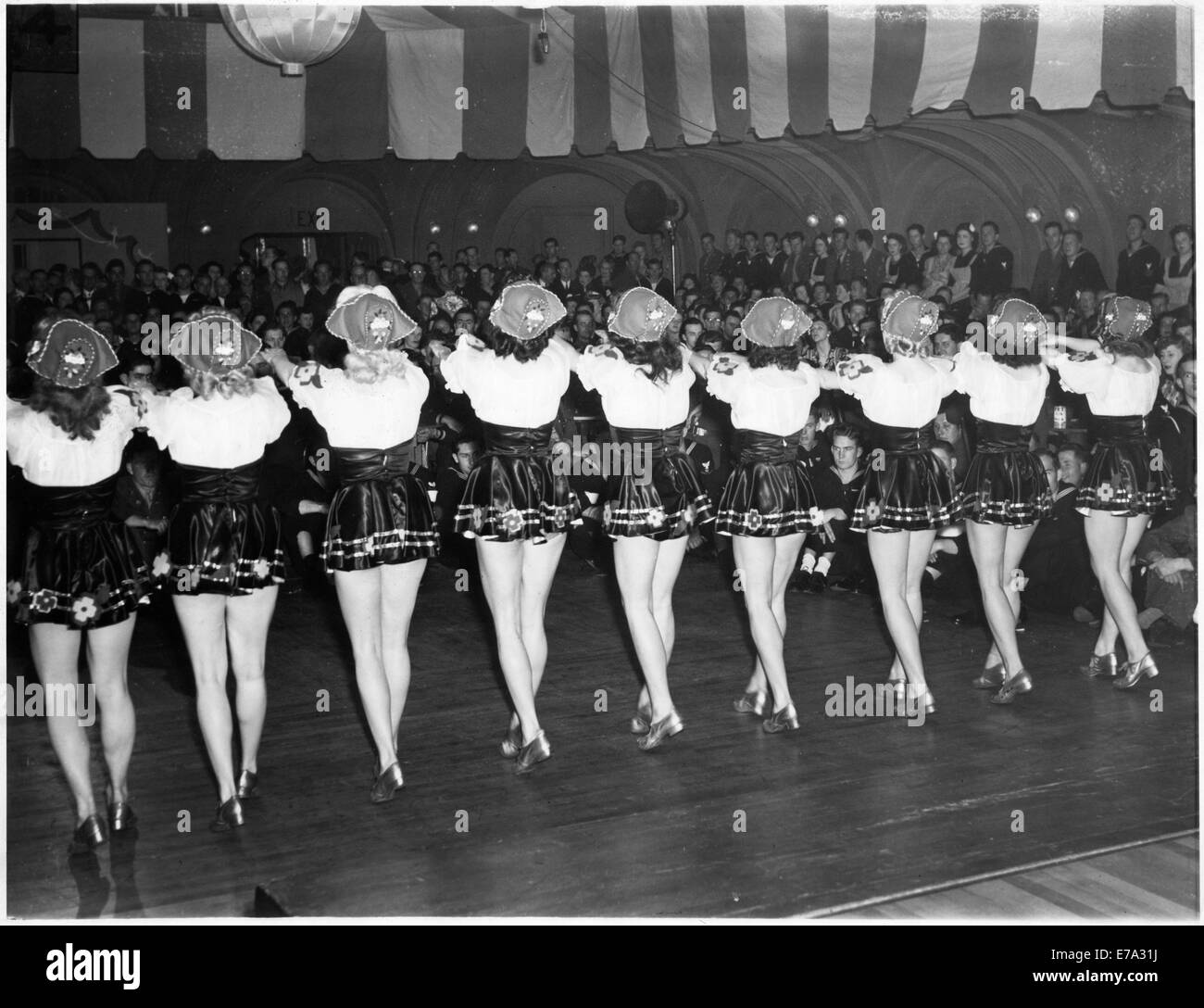 chorus girls performing for servicemen at stage door canteen during E7A31J during world war ii stock photos & during world war ii stock Wire Harness Assembly at n-0.co