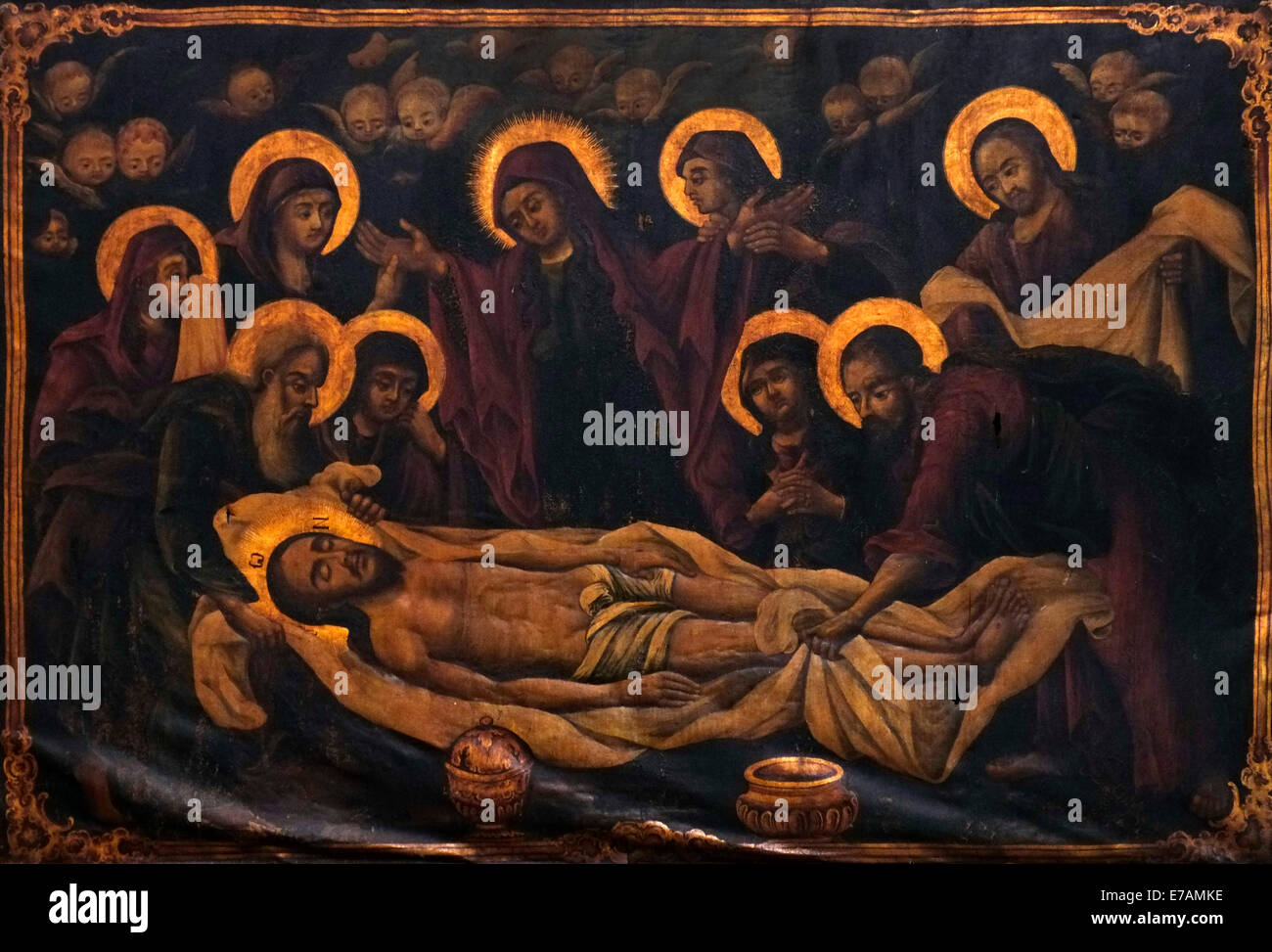 painting depicting jesus christ body being prepared for burial