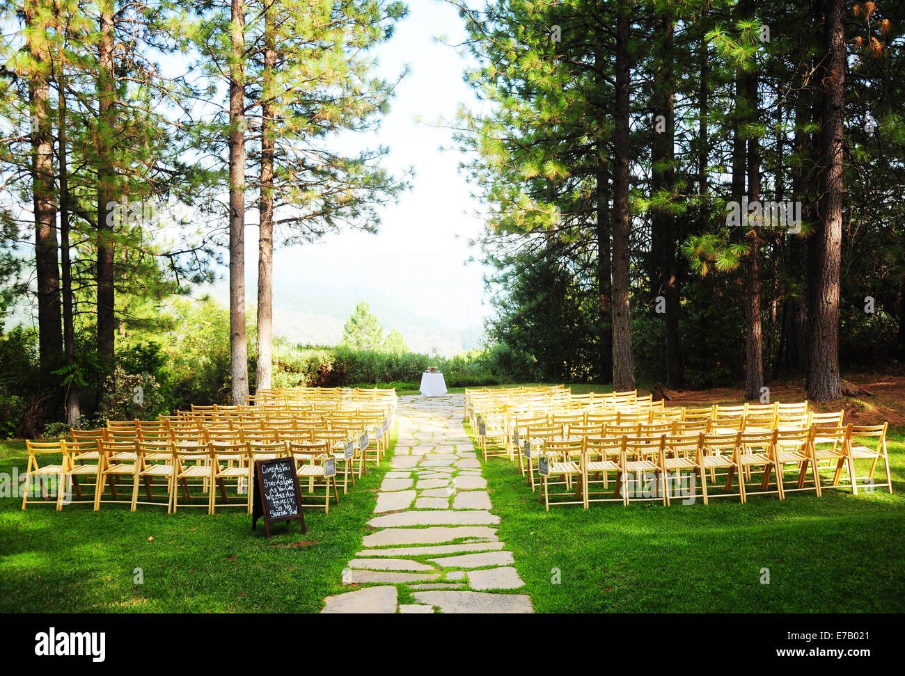 Wedding ceremony chair - A Mountain Top Wedding Ceremony Full Of Wooden Chairs In A Forest Clearing