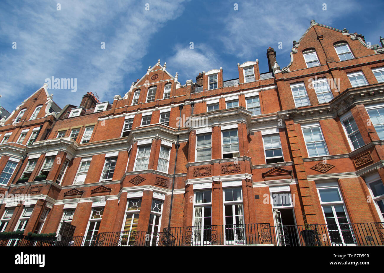 Row Of Red Brick Apartments In Mayfair, London, UK