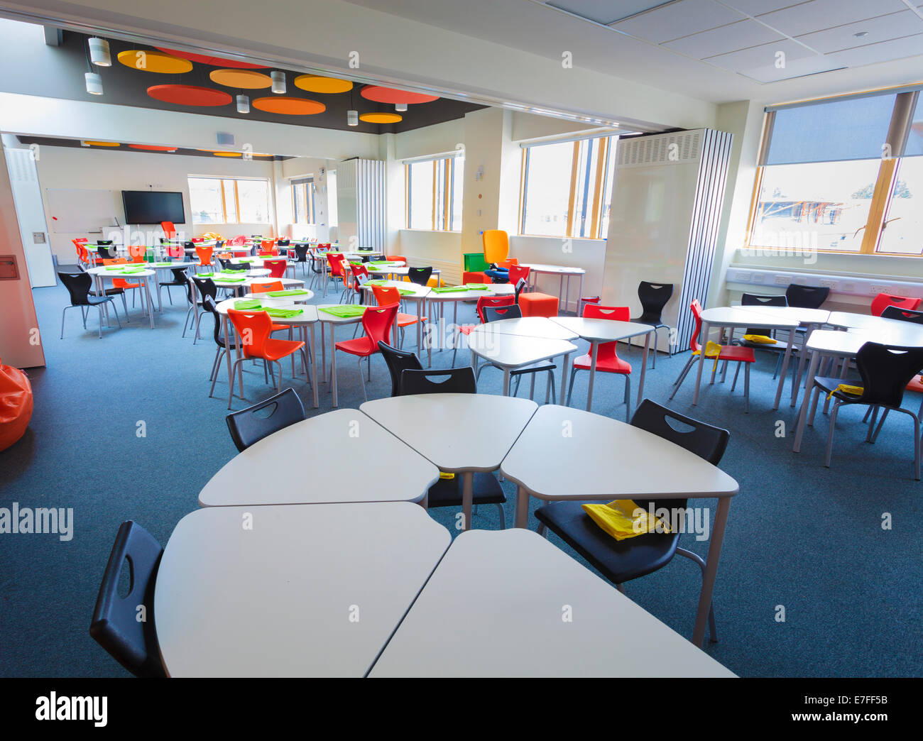 Modern High School Classroom Designs ~ Unoccupied modern school classroom with desks in a circle