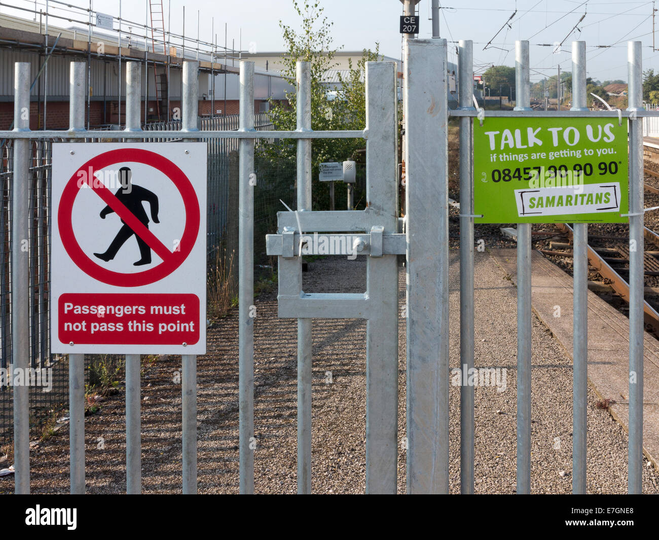 Two restriction signs on a gate at end of railway platform. One ...