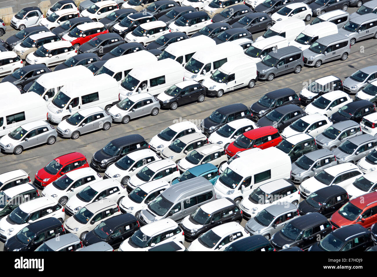 New Cars And Vans Held In Parking Lot On The Jetty At The Port Of