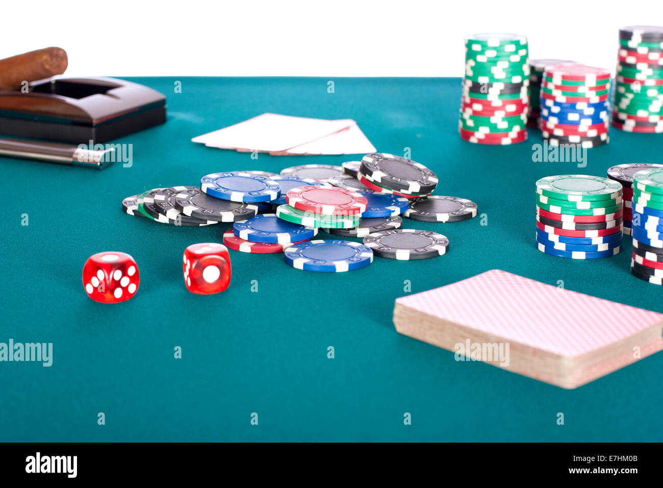 Poker table background - A Selection Of Various Value Poker Chips On A Green Felt Poker Table Background And Other Things With White Background
