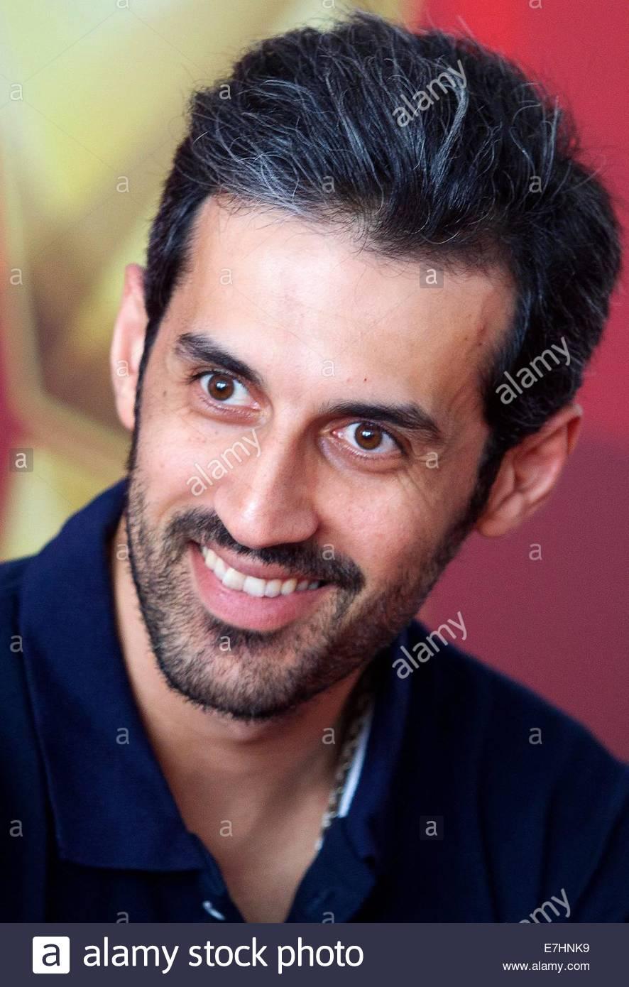 http://c8.alamy.com/comp/E7HNK9/epa04401909-irans-team-captain-mir-saeid-marouflakrani-smiles-during-E7HNK9.jpg