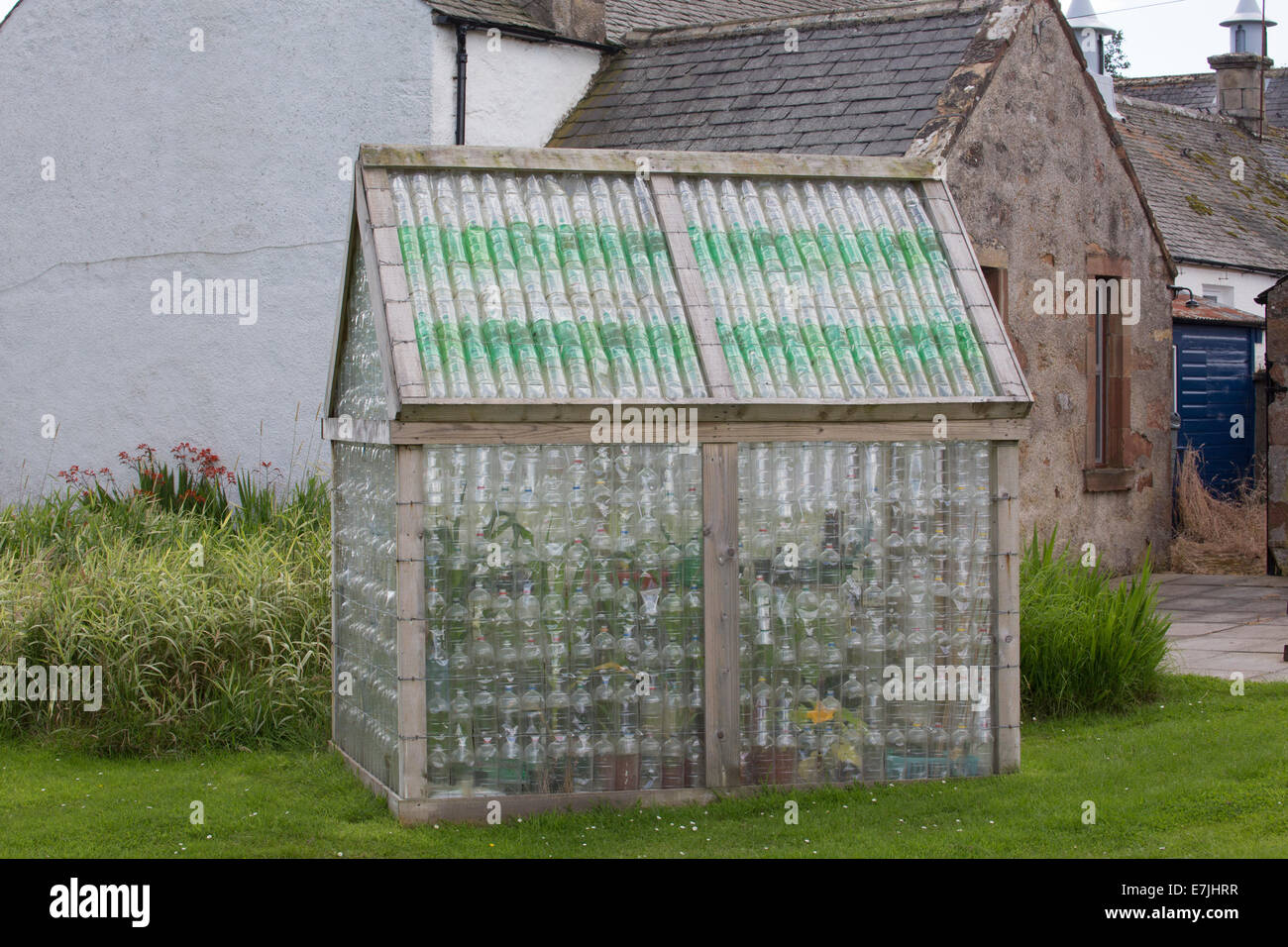 Greenhouse made from recycled plastic bottles stock photo for What is a greenhouse made out of