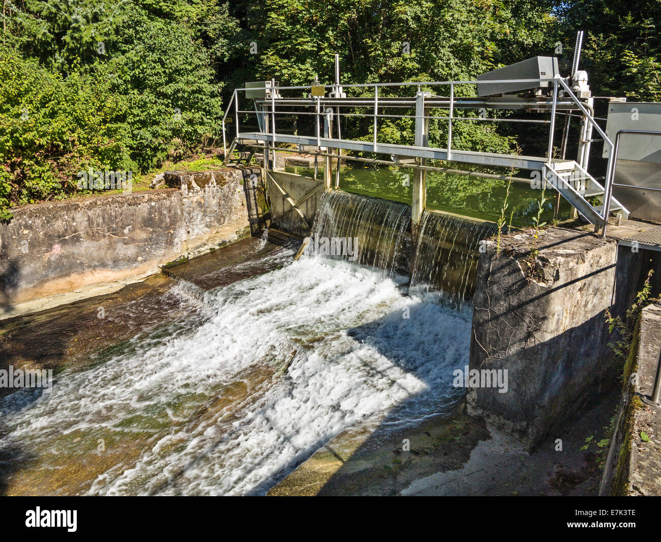 Mini Hydroelectric Dam : Small hydroelectric dam on a river in switzerland stock