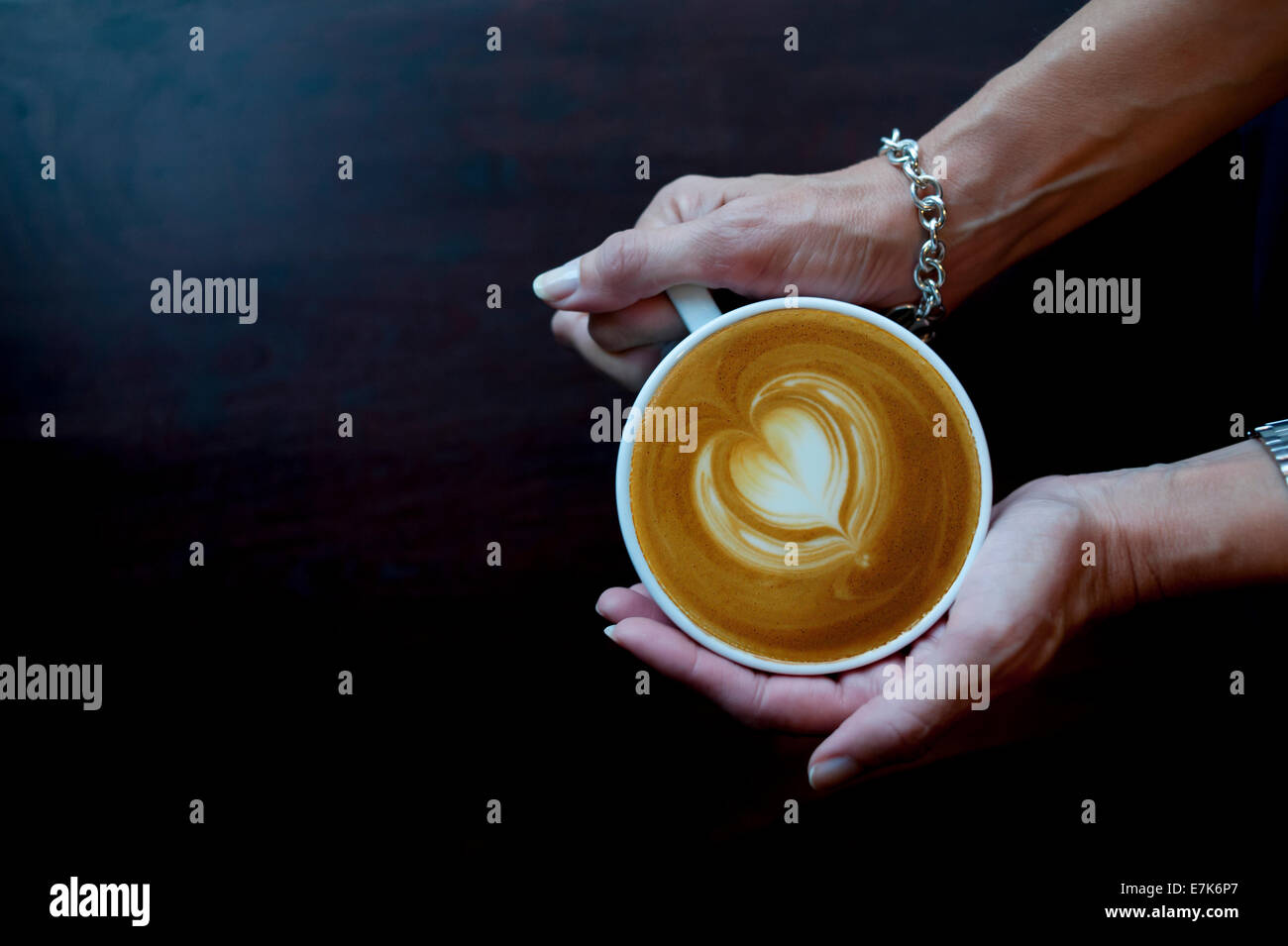 Mature-hands-of-a-woman-holding-a-coffee