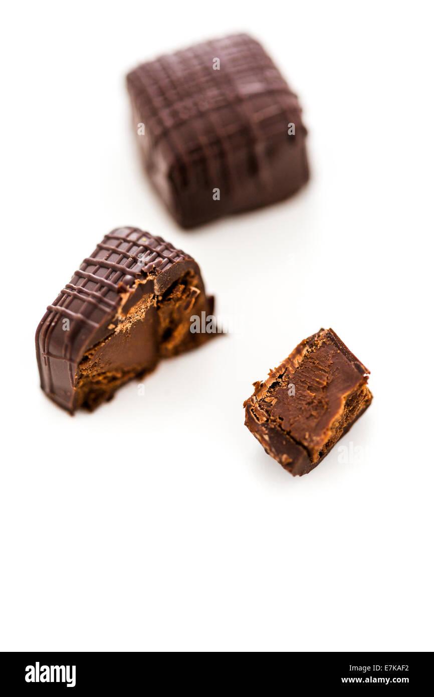 Gourmet 64% dark chocolate vegan truffle on a white background ...