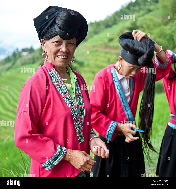 Yao Women Of Longji Area Demonstrating Their Long Hair