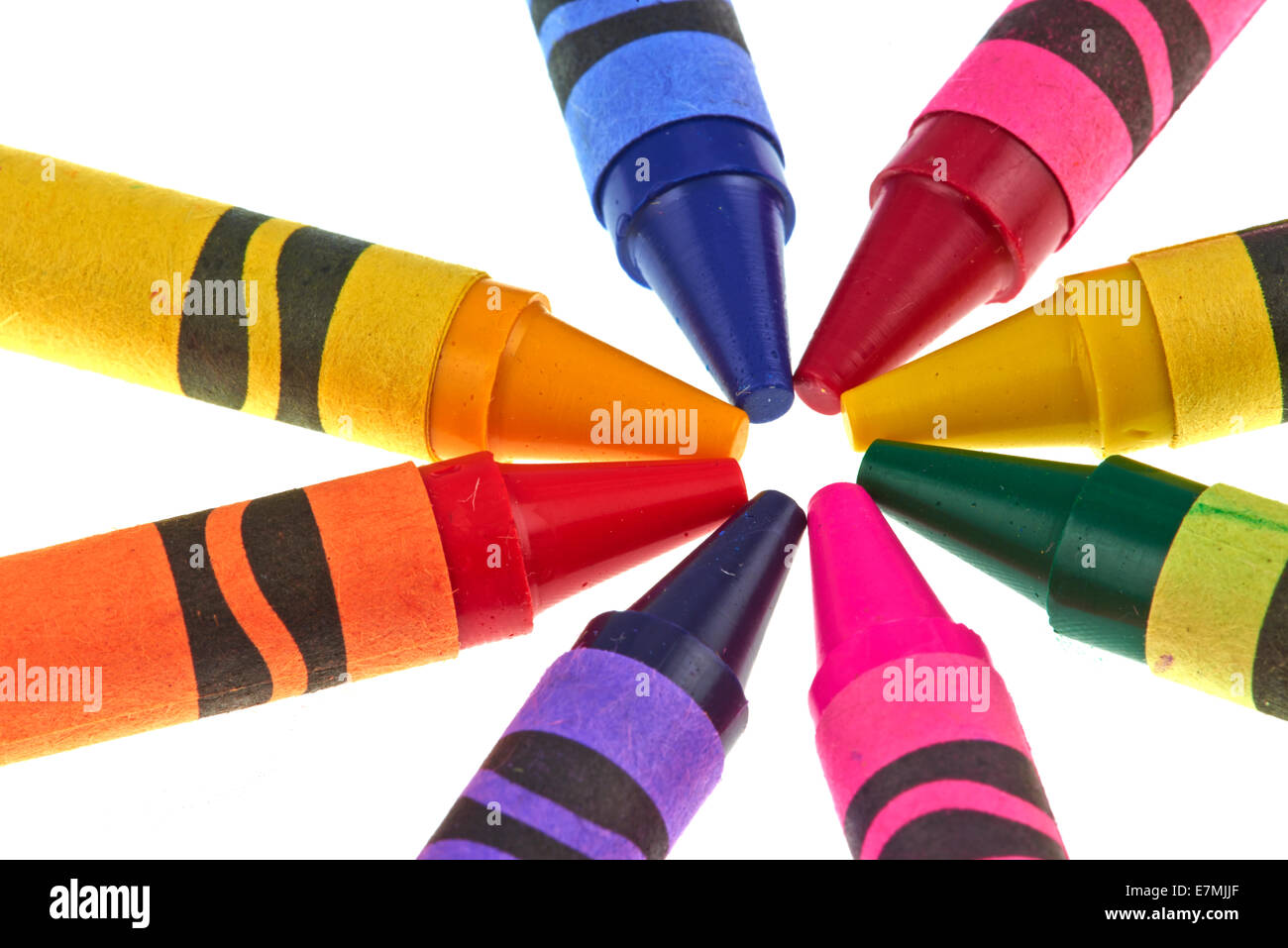 coloured crayola crayons arranged in a circle