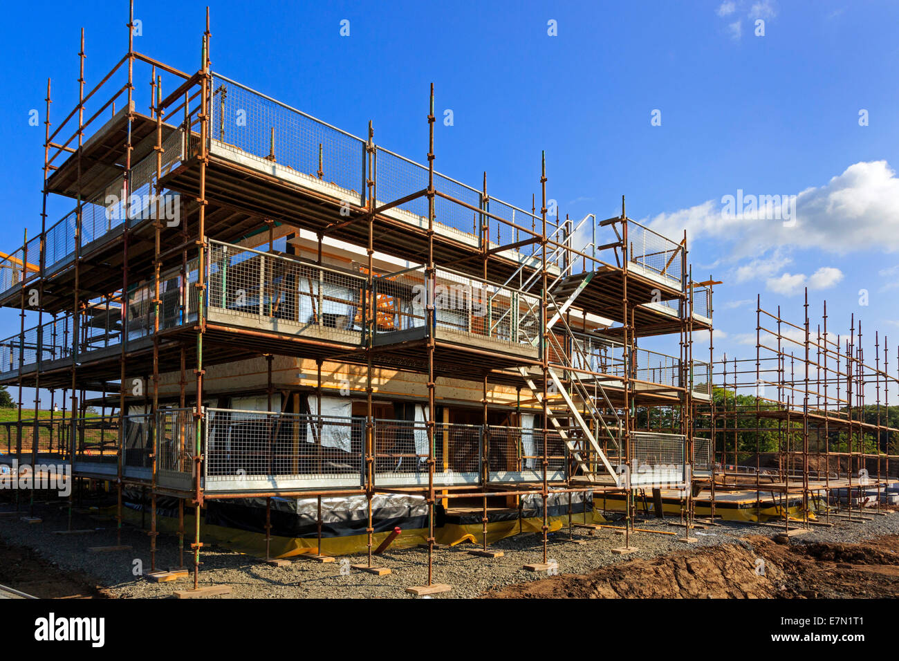 New build house under construction on a building site near for House building website