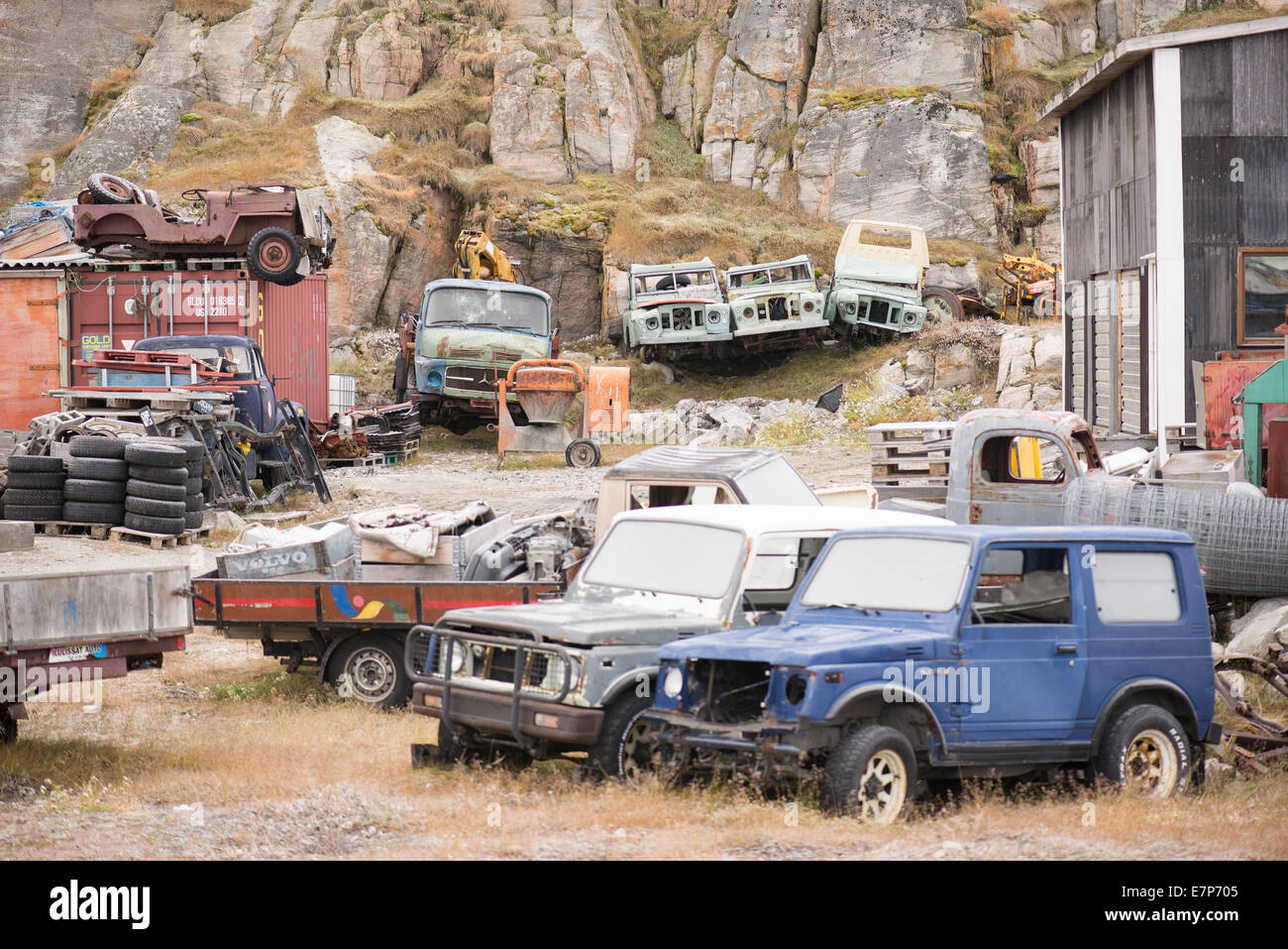 old discarded wrecked cars in greenland with army jeeps