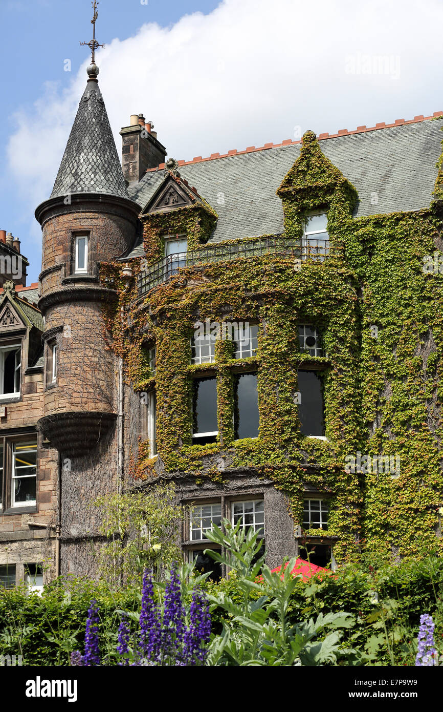 Victorian Gothic House an ivy clad, victorian gothic house at edinburgh zoo stock photo