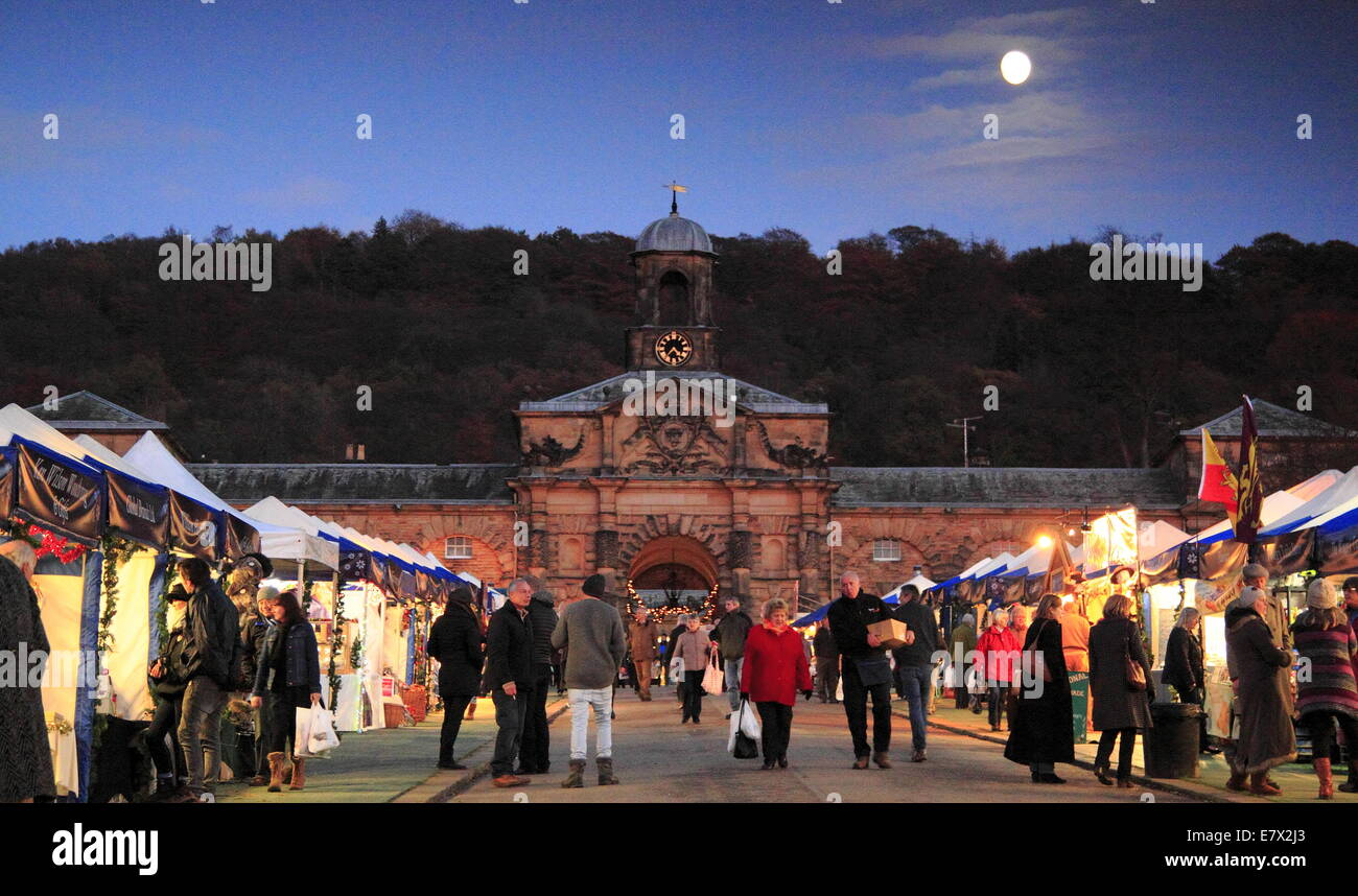 The Christmas Market in full swing outside the Stables in the grounds of Chatsworth  House, Peak District, Derbyshire England UK