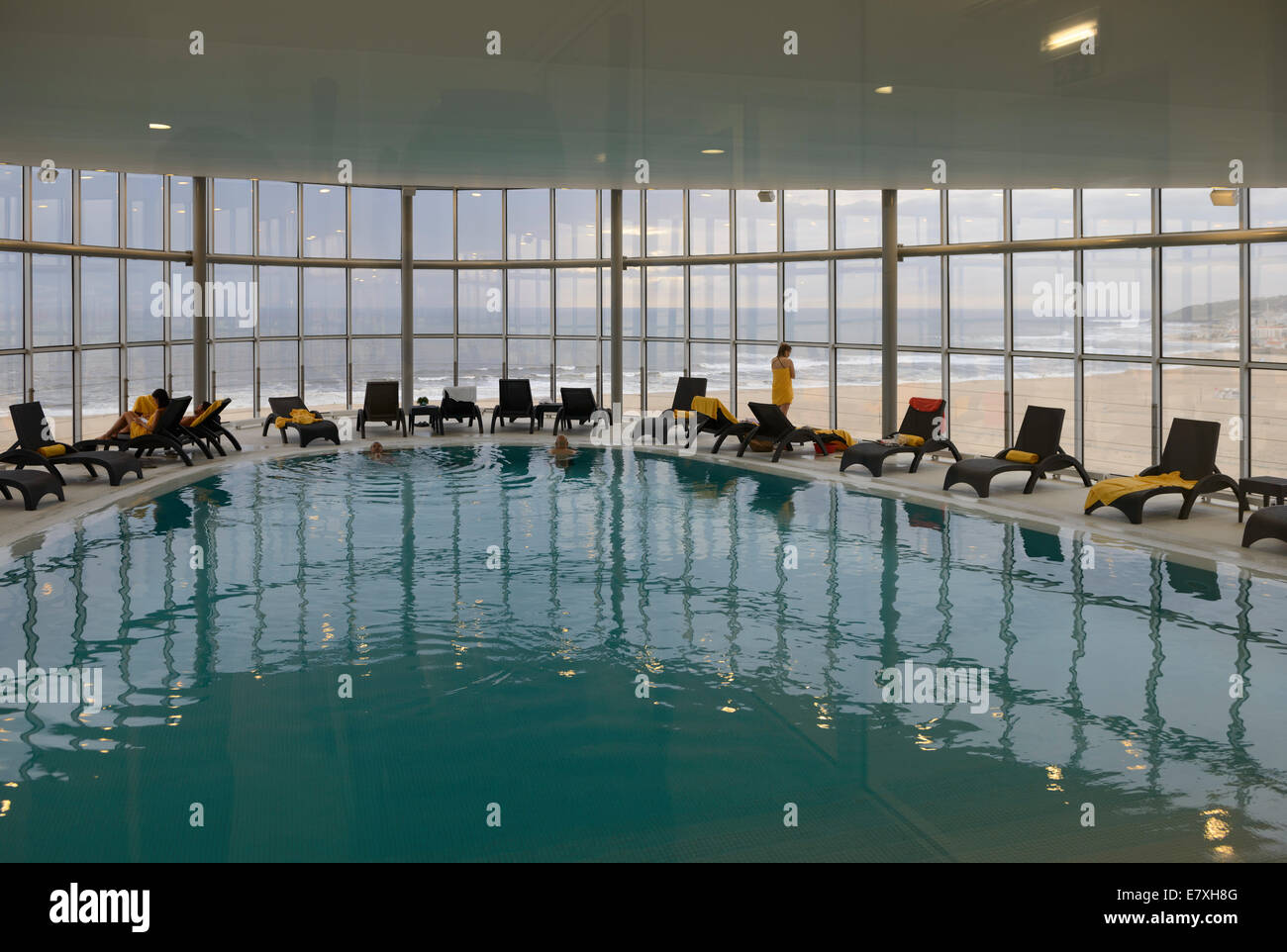 Hotel Indoor Swimming Pool With Large Window With A View To The Beach Stock Photo Royalty Free