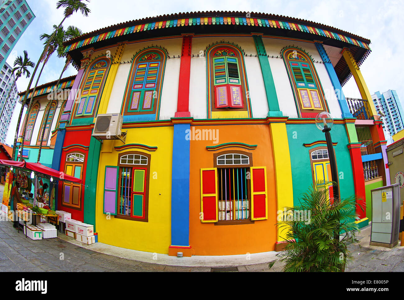 traditional rainbow coloured house with colourful windows