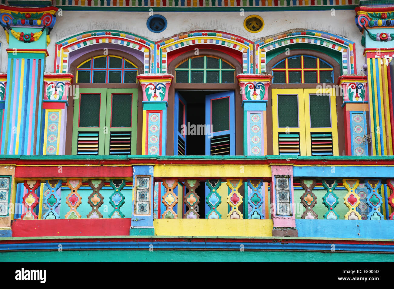 Traditional rainbow coloured house with colourful windows and shutters in little india in singapore republic