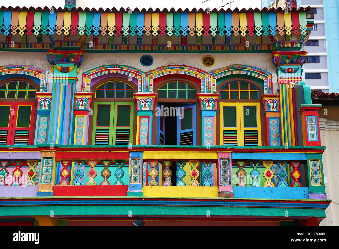 Stock photo traditional rainbow coloured house with colourful windows and shutters in little india in singapore republic of singapore