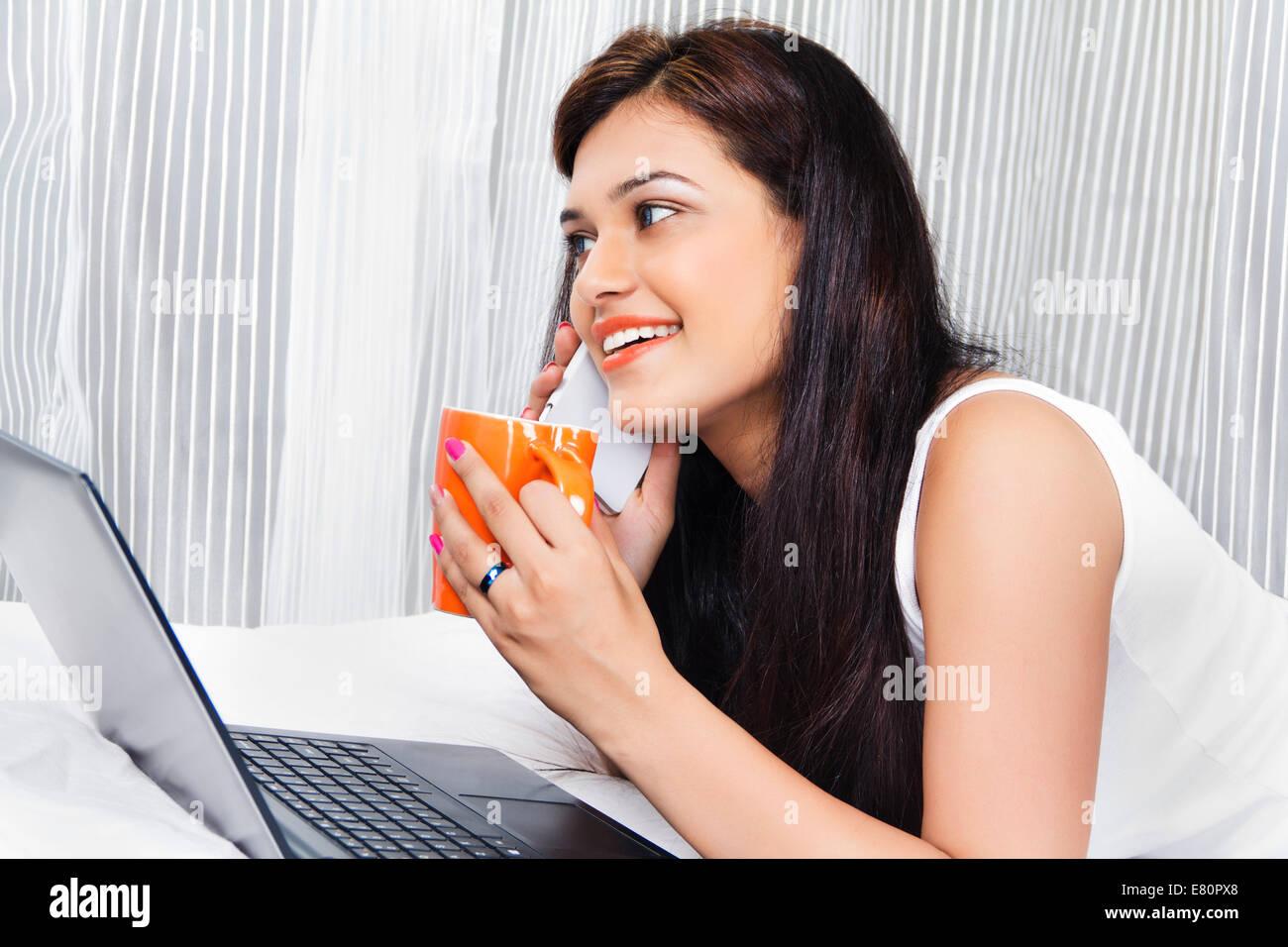 indian beautiful ladies talking phone stock photo royalty free