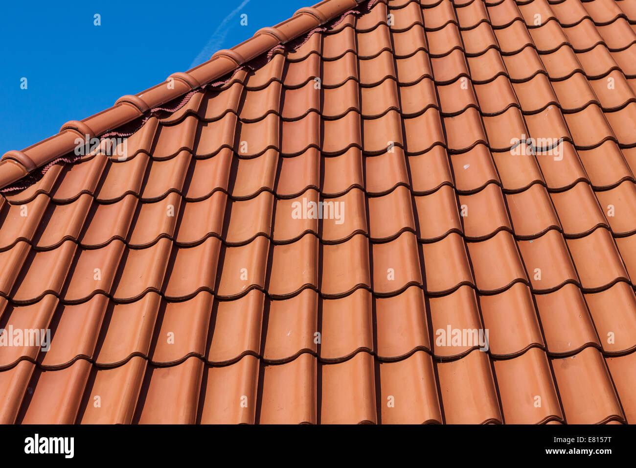 Red Roof Tiles Of A New House On Blue Sky