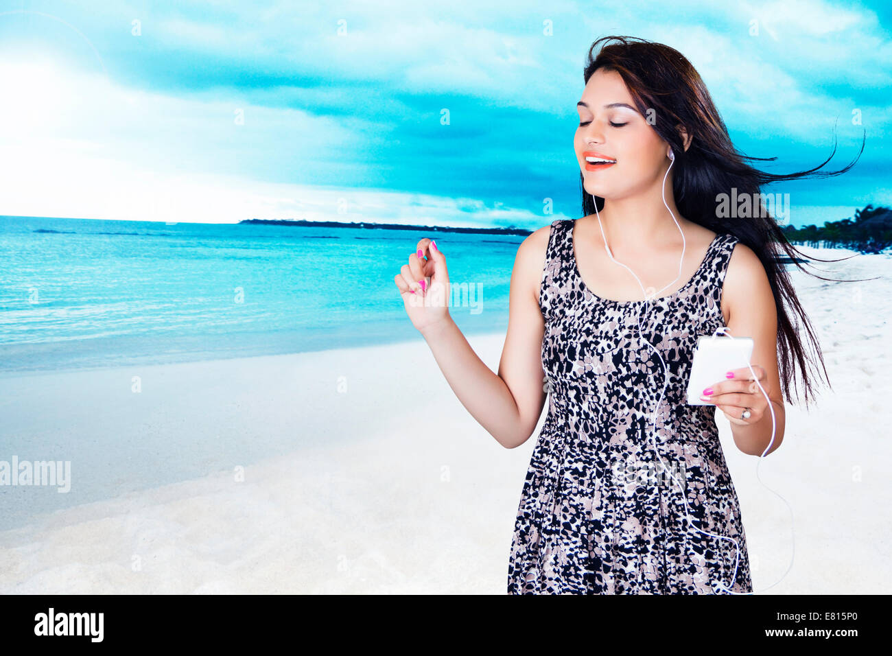indian beautiful ladies hearing music beach stock photo royalty