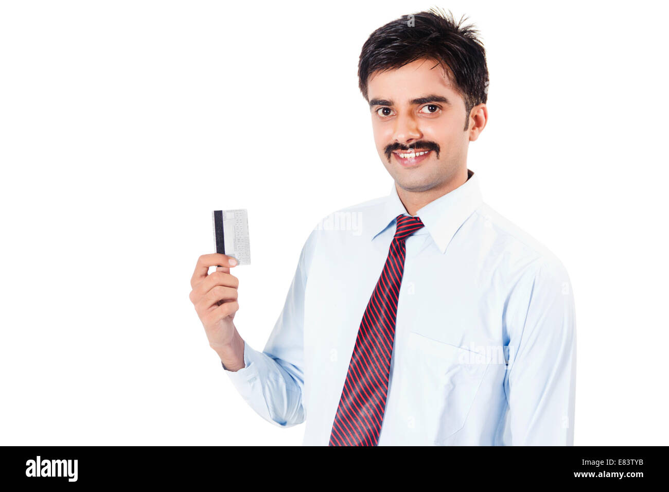 Indian business man showing credit card stock photo royalty free indian business man showing credit card reheart Choice Image