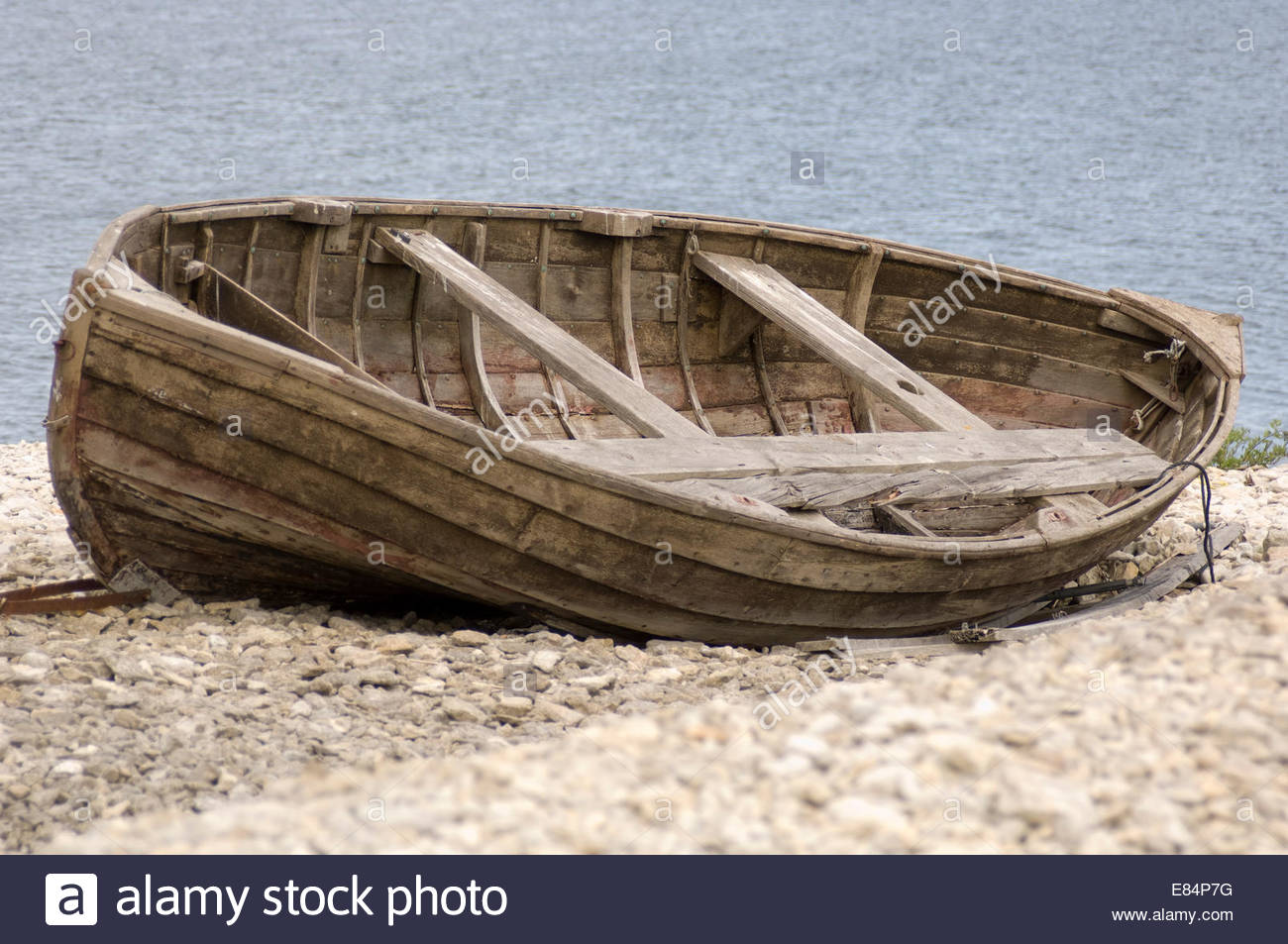 Old broken wooden boat on a beach Stock Photo, Royalty ...