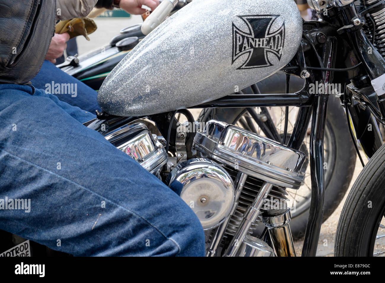 Close up of custom harley davidson motorcycle panhead engine detail and metalflake painted petrol tank on