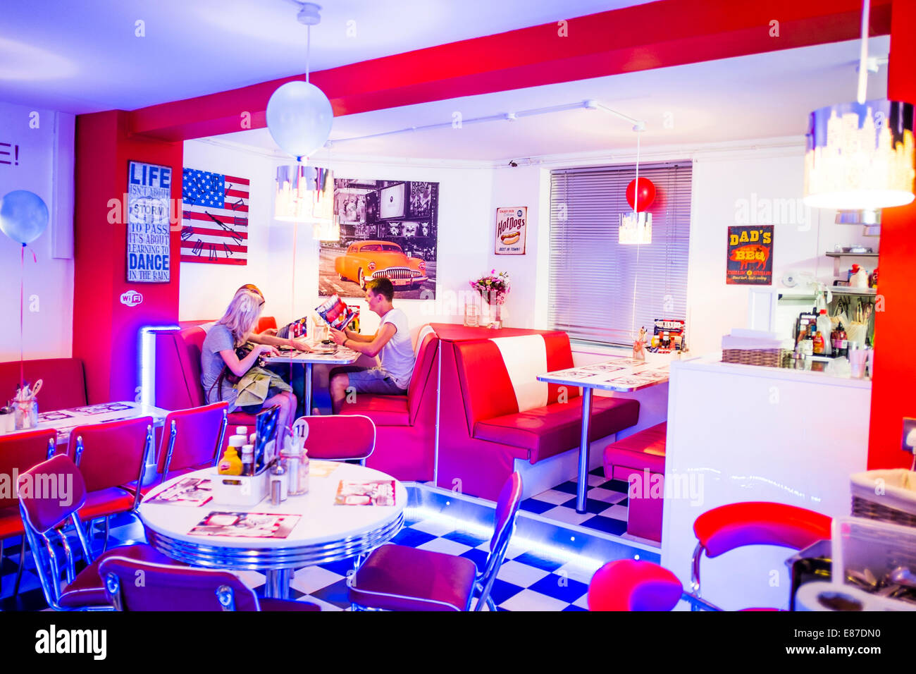 "interior: people eating in the ""aberyankee"" american diner style"