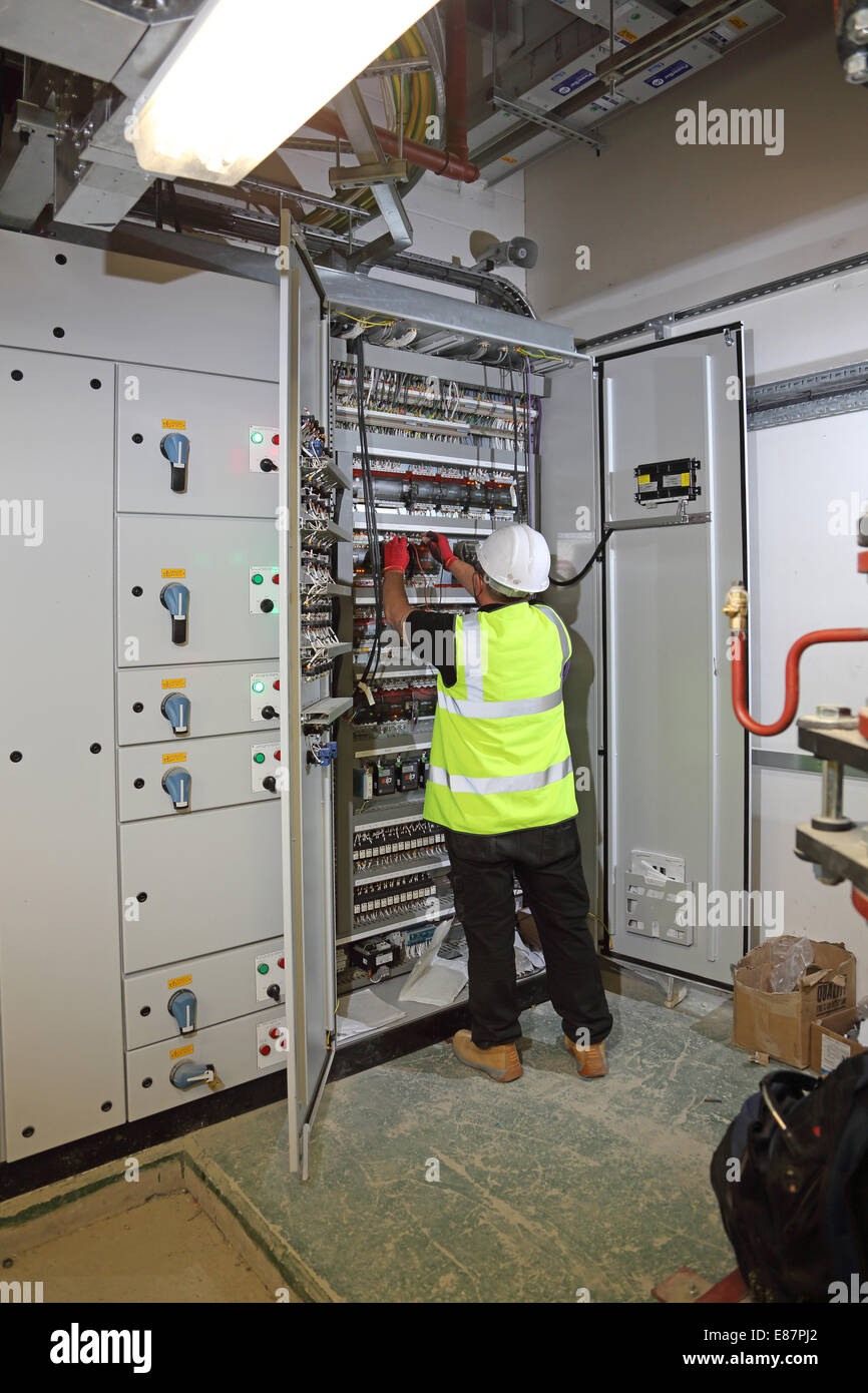A building services engineer works in an electrical for House electrical service