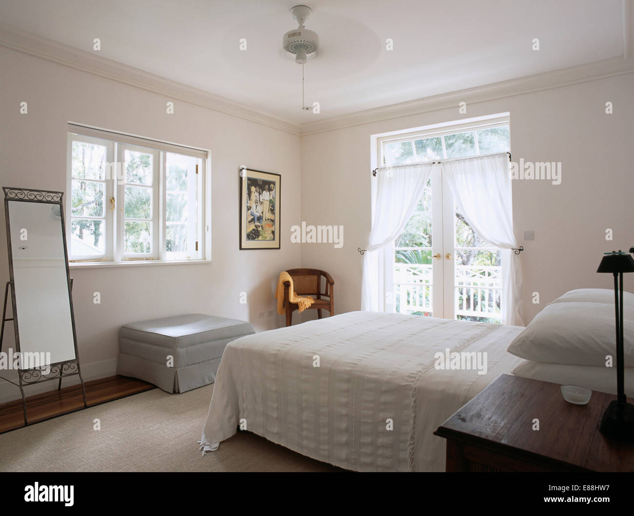 Modern White Bedroom In Barbados With Ceiling Fan Above
