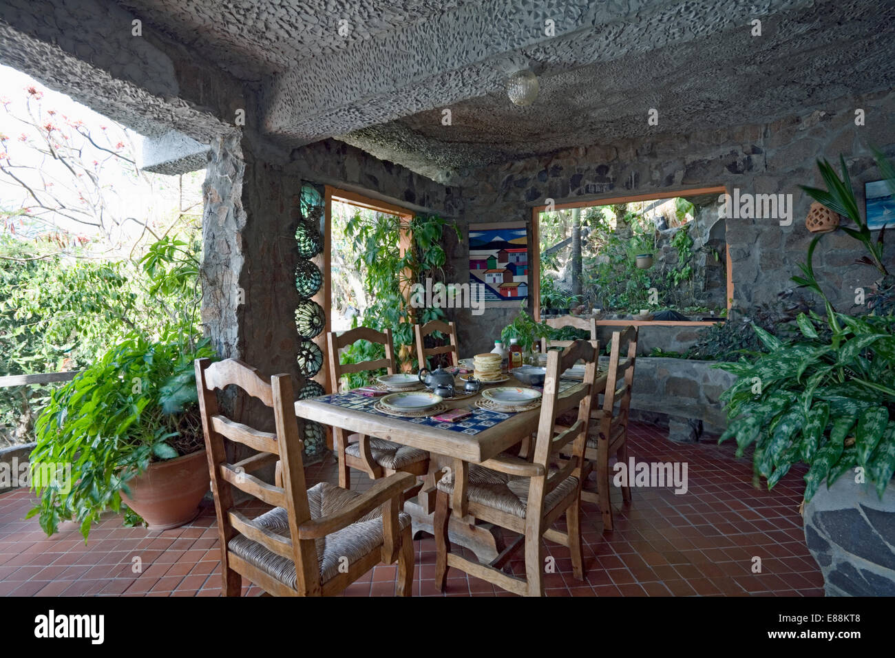 Rustic wooden table and chairs in dining area on veranda of house on stock photo royalty free - Veranda dining rooms ...