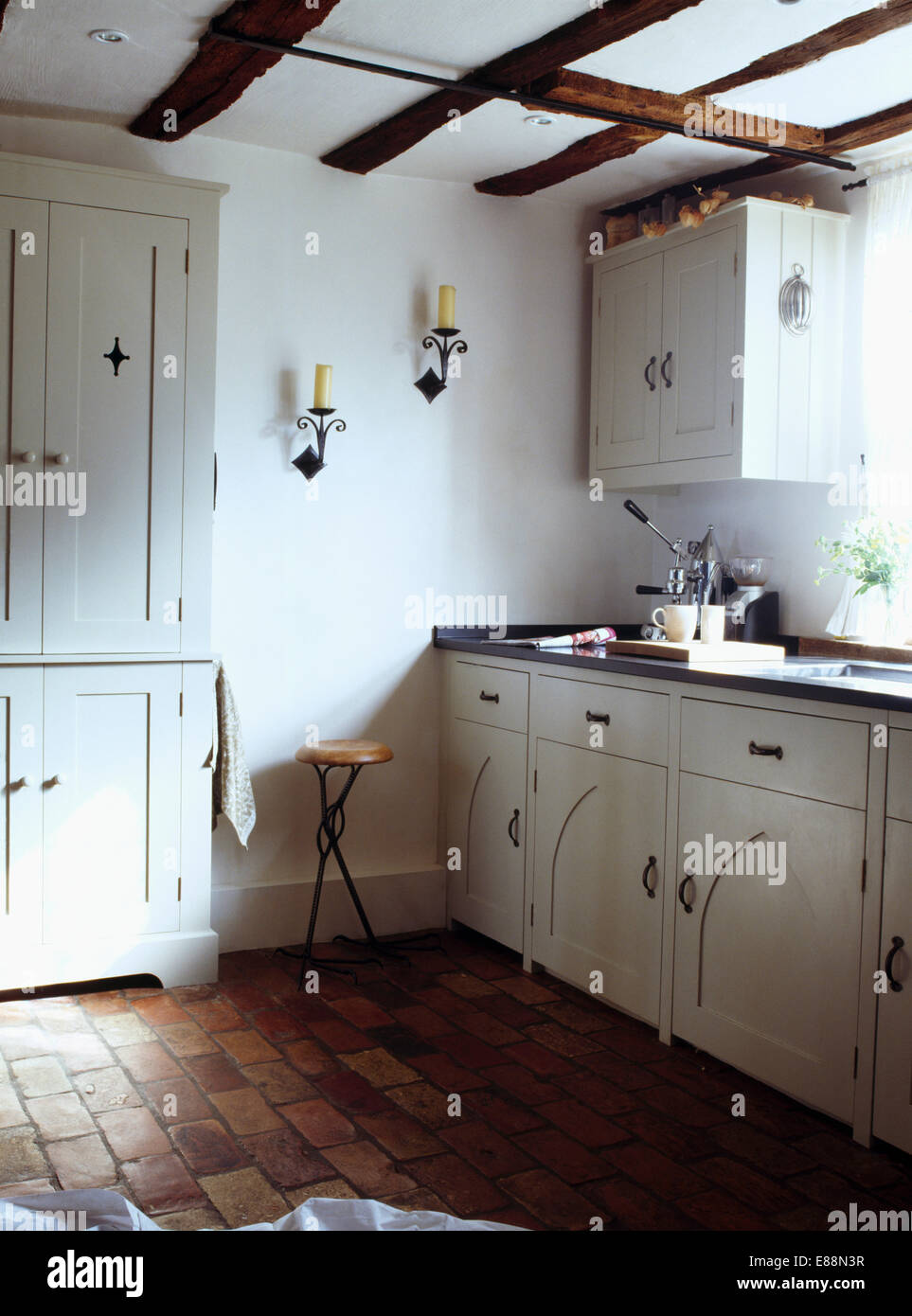 Brick Floors In Kitchen Old Brick Flooring In White Country Cottage Kitchen Stock Photo