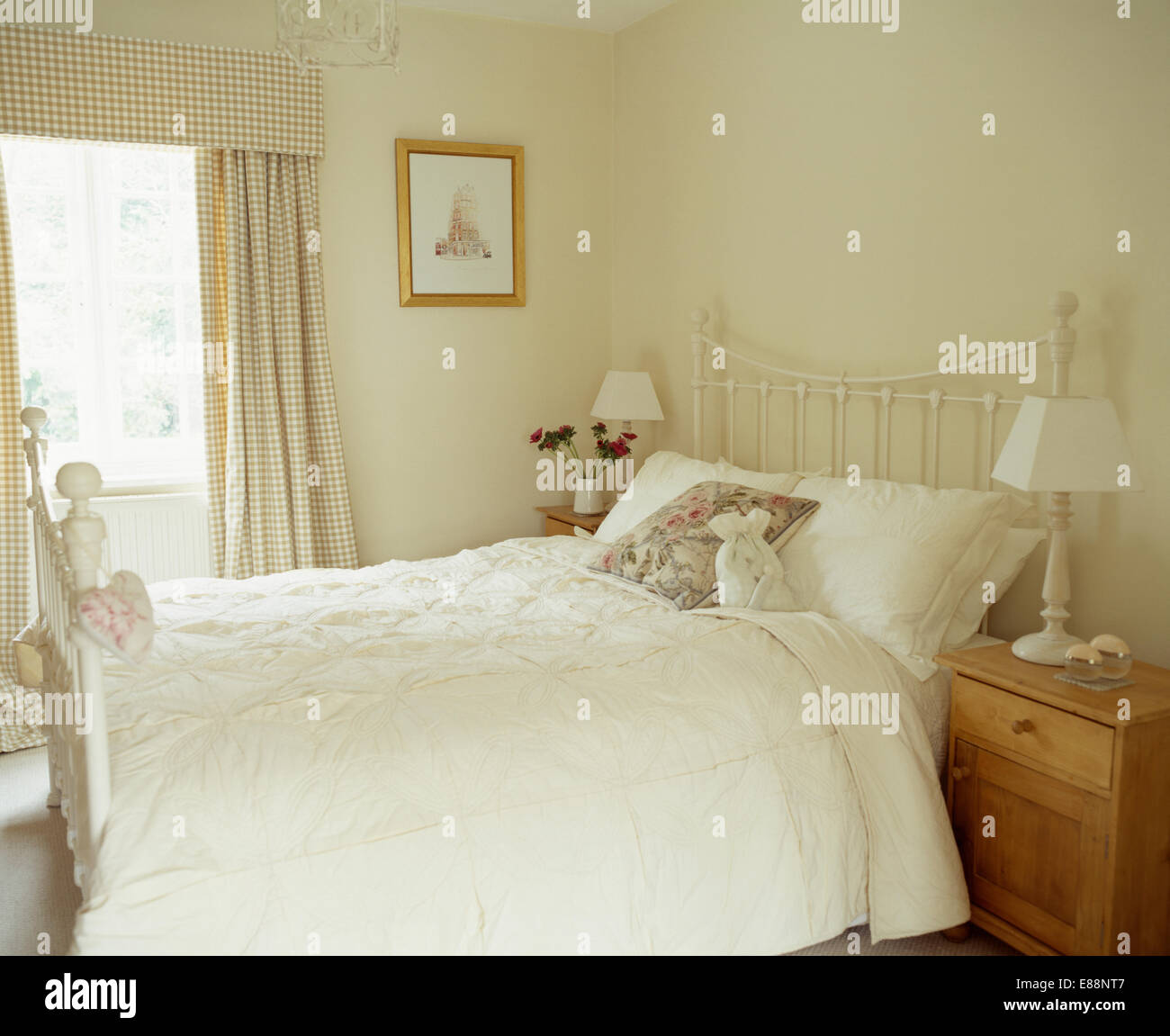 Stock Photo   White Quilt On White Painted Brass Bed In Simple Country  Bedroom With Cream+brown Checked Curtains
