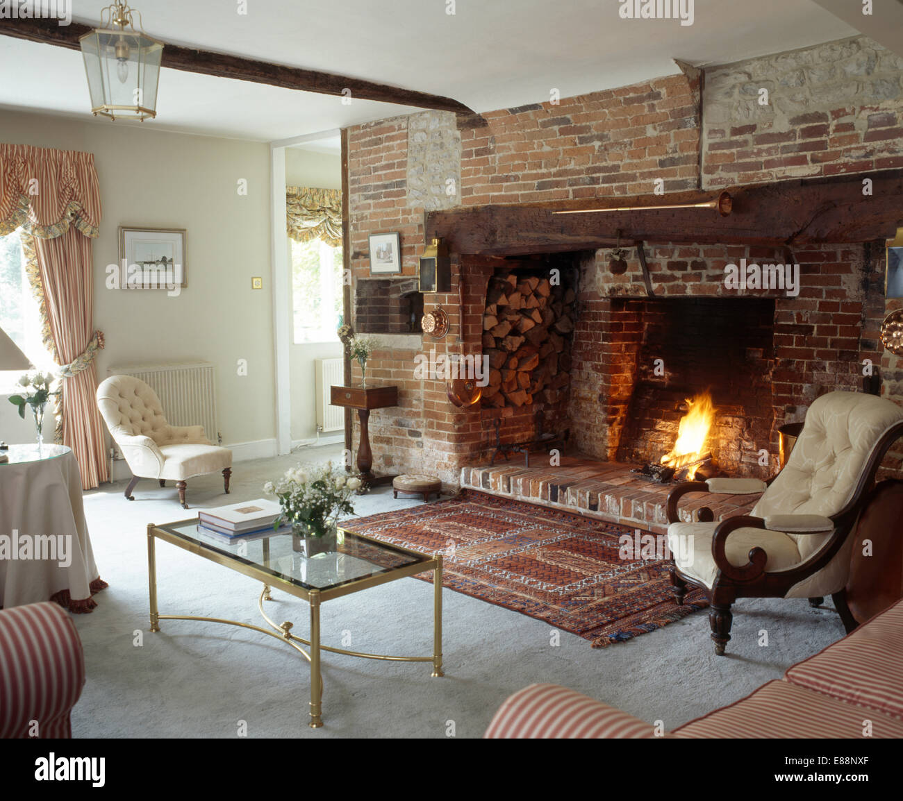 oriental rug in front of inglenook fireplace in cottage living