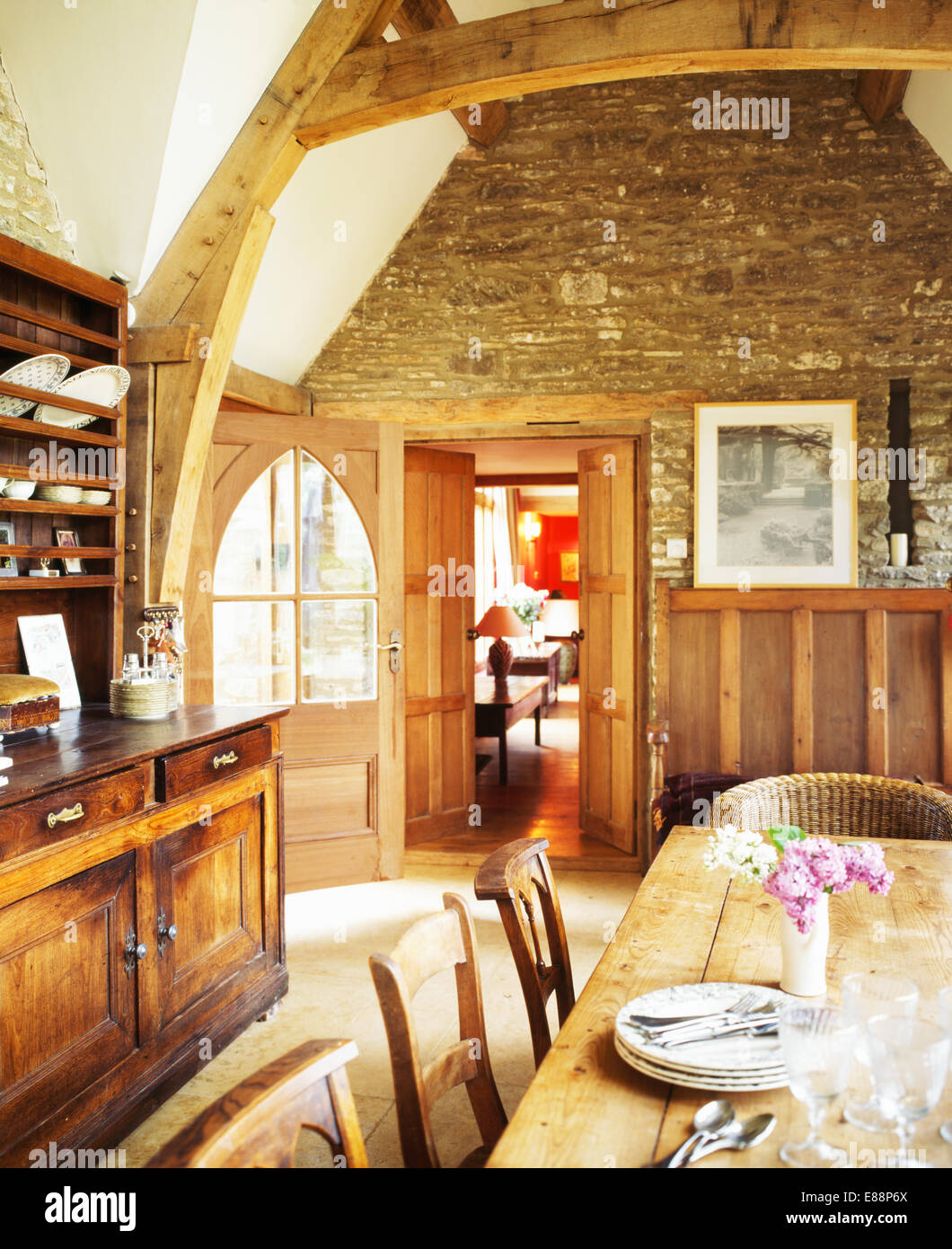Uncategorized Exposed Wooden Beams exposed stone wall and large wooden beams in barn conversion dining room with antique dresser pine table